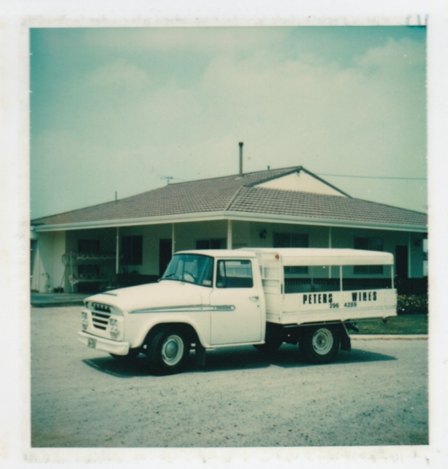 Peter's original delivery truck. The house in the background is the winery's current cellar door.