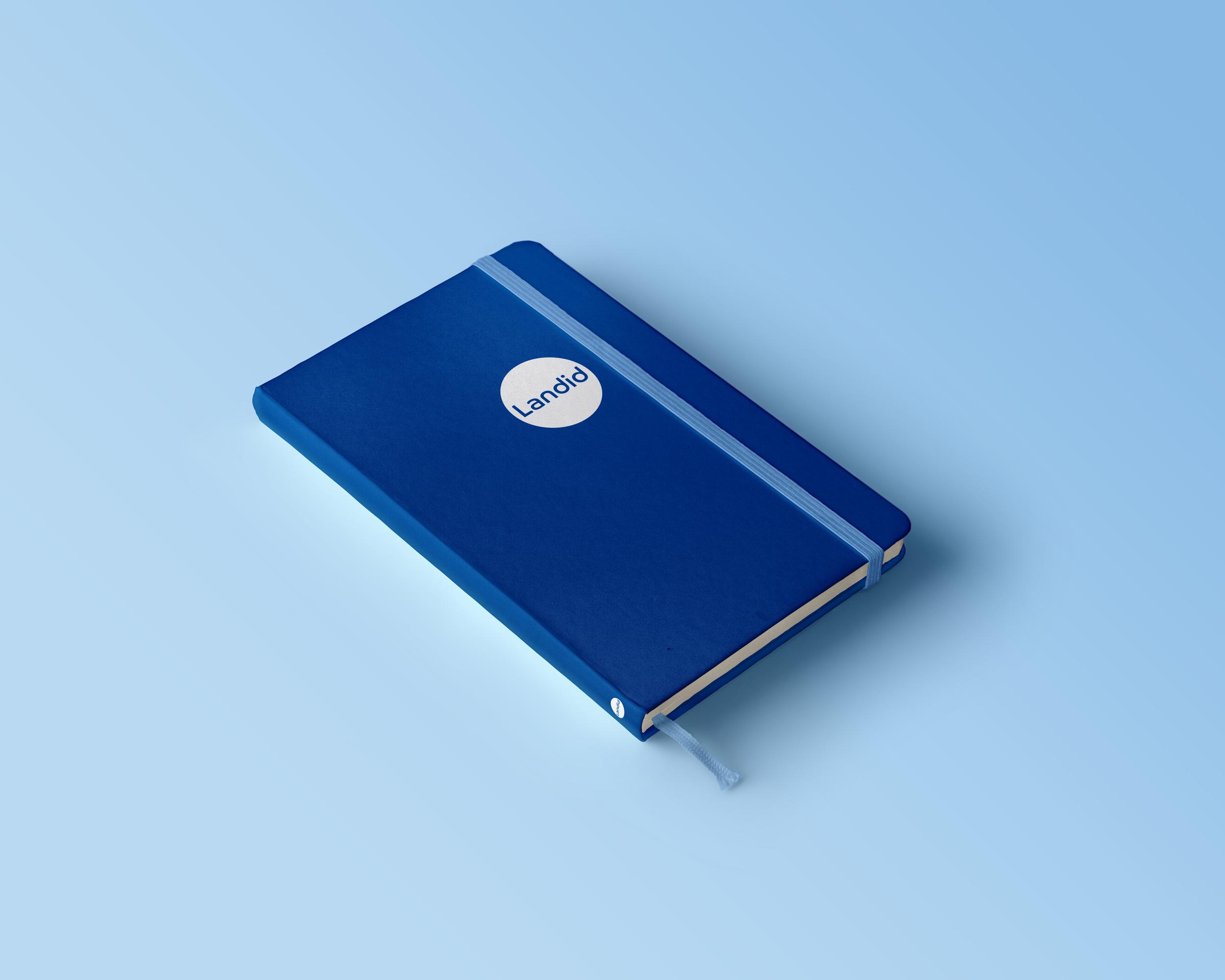 Landid branded moloeskin notebook against an on trend light blue back drop