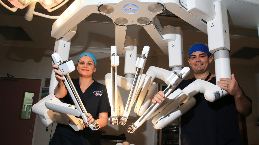 Dr Liz Jackson has performed the first ever robotic hysterectomy in Cairns at the Cairns Private Hospital. Dr Jackson is pictured with Theatre Technician Troy Wong. PICTURE: JUSTIN BRIERTY