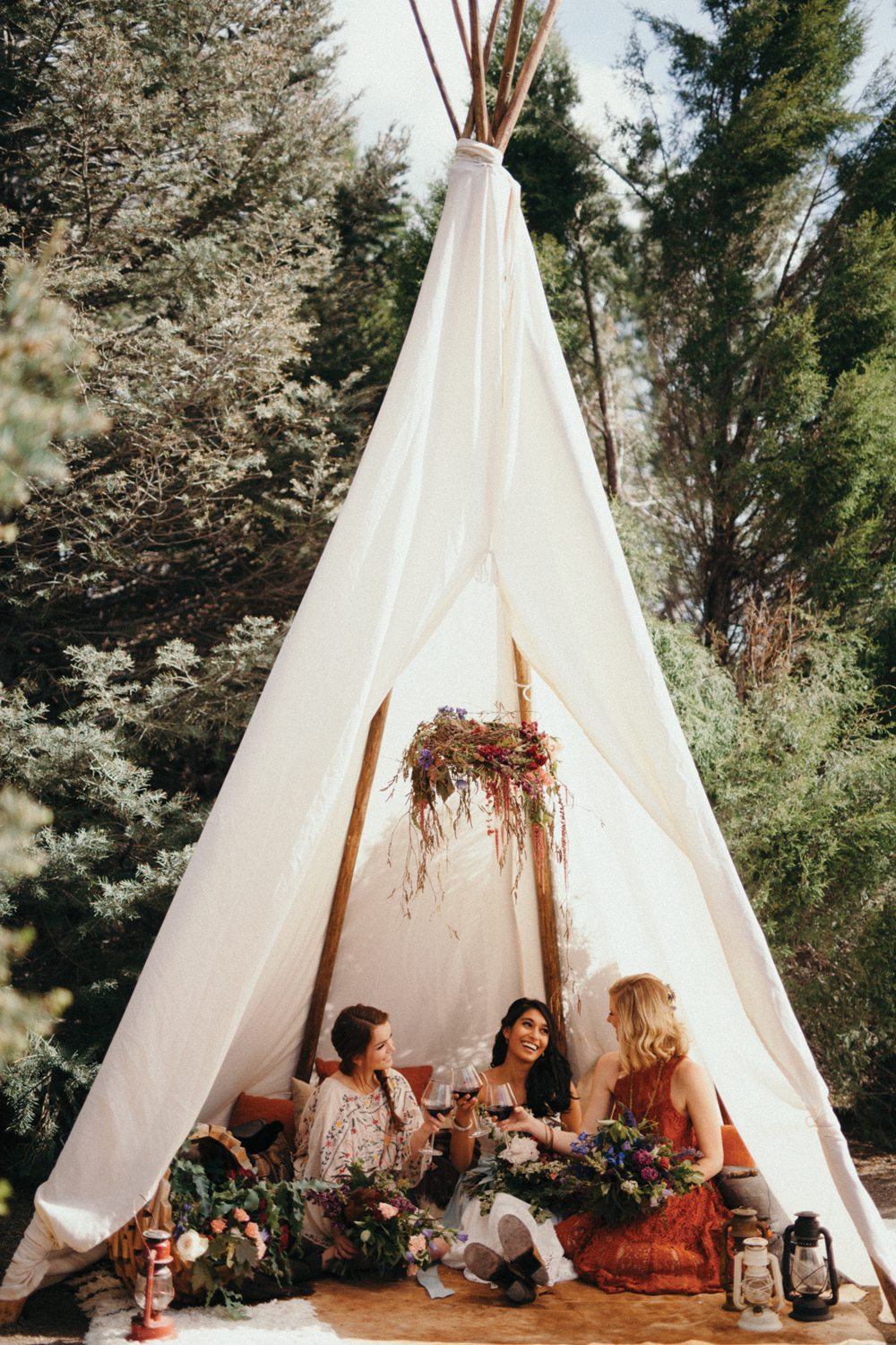 Outdoor Hideaways ….  Create cozy garden tents for your guests to enjoy. A nice place to relax before a big dinner reception.  Image Credit   Cassi Rosch