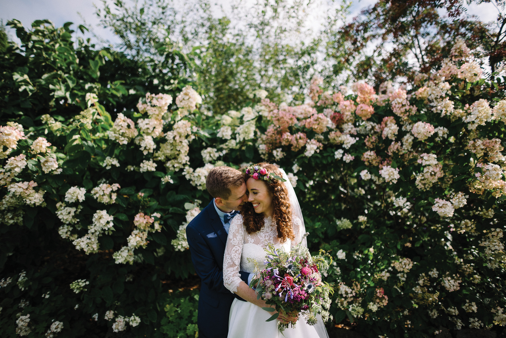 Beautiful Blooms ….  Botanical beauty adds wow factor to any wedding photographs. Outdoor gardens walls adds new heights of beauty to your day.  Image Credit   Epic Love