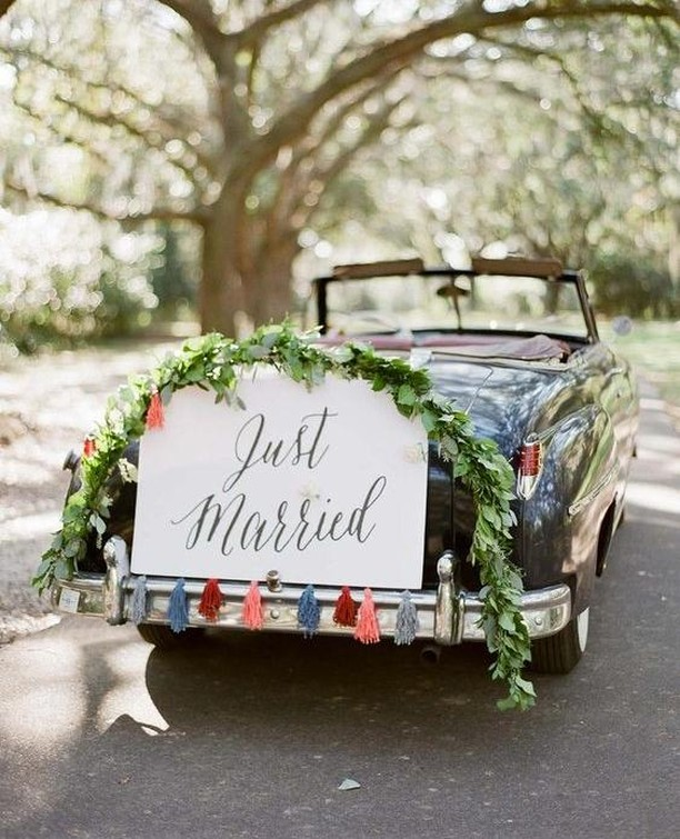 Once an old-fashioned tradition, the wedding car sign has been given a modern, stylish and on-trend twist. Why not arrive at your reception venue with a 'Just Married' sign on the back of your car. Image by gregfinck.com  #weddingcar #weddingcarideas #weddingcarsign #weddingcars #weddingcarsigns #weddingcarideas #instawedding #irishwedding #weddingplanning #northernirishwedding #wedding #bridalstyle #weddinginspo #weddinginspiration #inspireweddings #weddingdress #bride #groom #inspire #inspireweddingsmagazine  #weddinginspo #wedding #weddingparty #irelandwedding #weddingireland  #weddingceremony #weddingphotos #weddingreception 