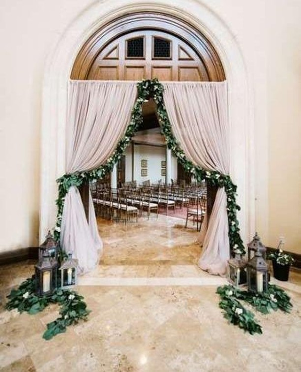 How pretty is this? The vibrant blooms and drapes transform this doorway into a scene of truth romance and beauty. ⁠ ⁠ ##weddingceremonydecor  #weddingceremonyflowers #weddingceremonyideas #weddingceremonyidea⁠ #instawedding #irishwedding #weddingplanning #northernirishwedding #wedding #bridalstyle #weddinginspo #weddinginspiration #inspireweddings #weddingdress #bride #groom #inspire #inspireweddingsmagazine  #weddinginspo #wedding #weddingparty #irelandwedding #weddingireland  #weddingceremony #weddingphotos #weddingreception ⁠ ⁠ ⁠