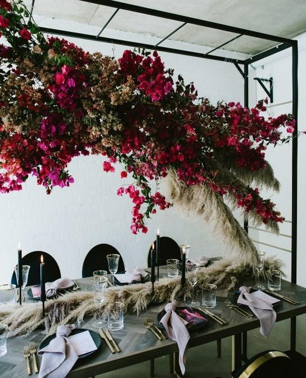 How about some stunning flowers but, instead of draped on the table, they're dangling from the ceiling! Overhead floral arrangements are wedding trend we adore and this image is a thing of true beauty. ⁠ ⁠ #flowerinstallations #flowerinstallationsideas #flowerinstallationswedding #weddingflowerinstallations⁠ #instawedding #irishwedding #weddingplanning #northernirishwedding #wedding #bridalstyle #weddinginspo #weddinginspiration #inspireweddings #weddingdress #bride #groom #inspire #inspireweddingsmagazine #theone #weddinginspo #wedding #weddingparty #irelandwedding #weddingireland #weddingreception ⁠ ⁠