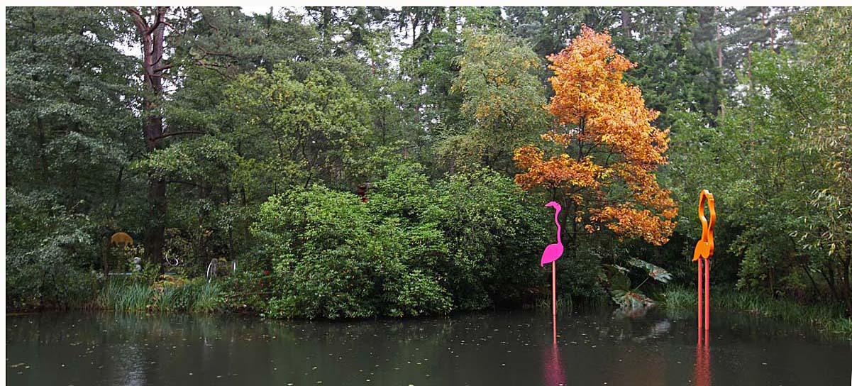 Flamboyance of Flamingos. Painted steel. (Image: courtesy The Sculpture Park)  Large orange pair, 5 metres high x 1.5 metres wide. Set on a submersible, separate, galvanised steel platform.  Large pink single, 5 metres high x 1 metre wide. Set on a submersible, separate, galvanised steel platform.