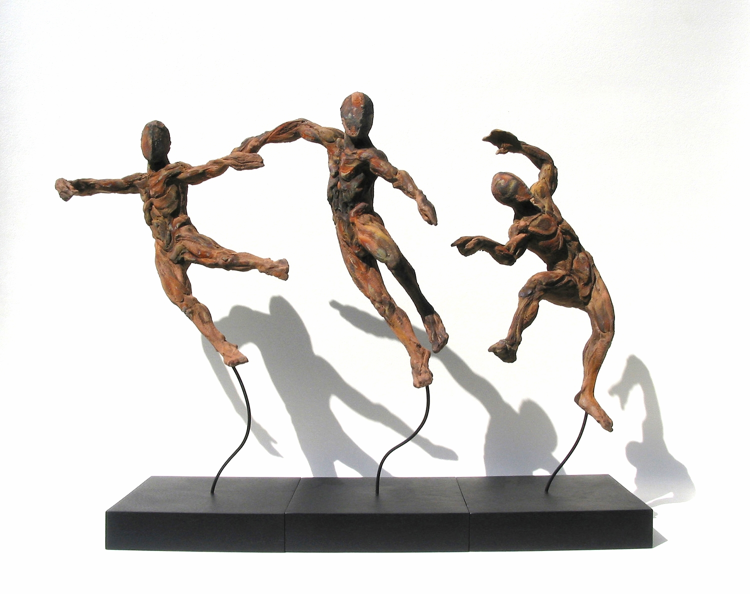 Switchback  ©  66 cm high x 90 cm wide  Unique.  Diamantopoulo's figuration is both an exploration of the human form in its many guises and the conjoining of man, woman and beast.  It takes many shapes and forms whether classical, dynamic, pared down, abstracted or cut very often with subversive wit.  Dancing in the flames of some infernal place, faceless human figures emerge from the raw stuff of life in these quick sketches in clay.