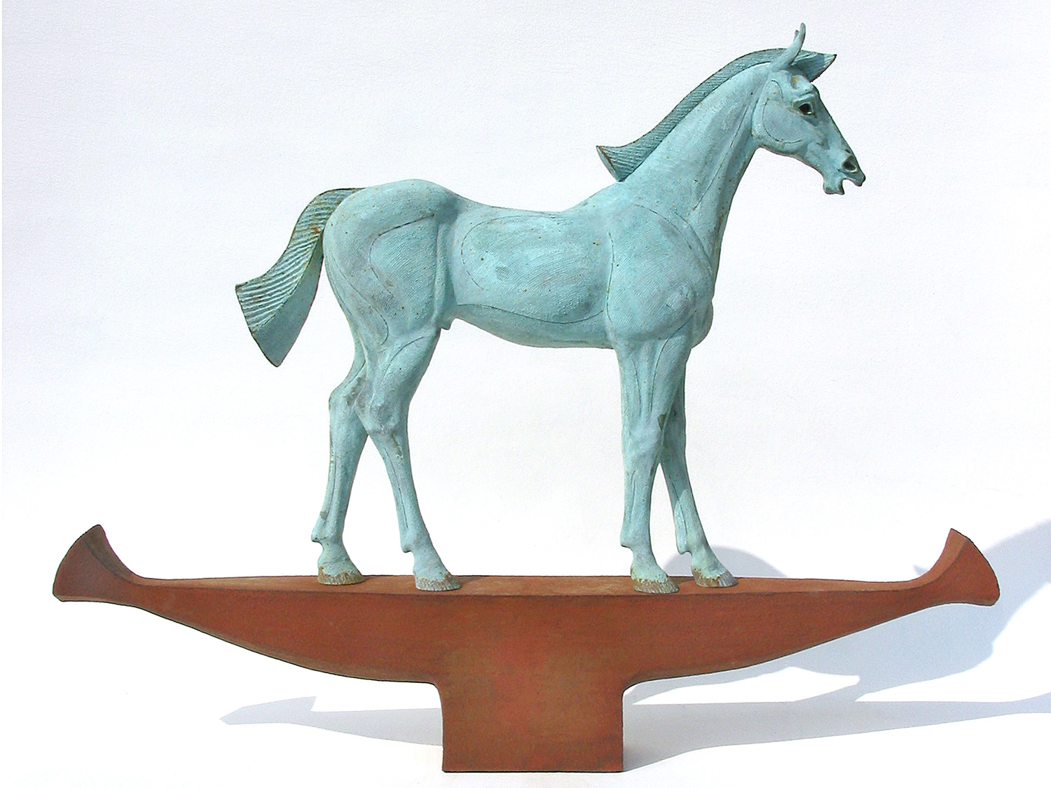 Bucephalus   ©  79 cm high x 94 cm wide  Unique  Subverting the concept of the horse as the object being mounted - it is the horse that is now mounted on a pedestal or, as in this case, a pedestal masquerading as a vessel.  The horse as passenger and not as conveyor and the vessel as a means of bearing the noble creature aloft, is a recurring theme.  Here, Bucephalus, Alexander the Great's favourite horse, travels down the Nile on a royal, reed, horse- barge.  It is no accident that the barge also mimics a blacksmith's anvil. The 'anvil' anchors the piece, accentuating its gravitas whilst negating any sense of floatation.