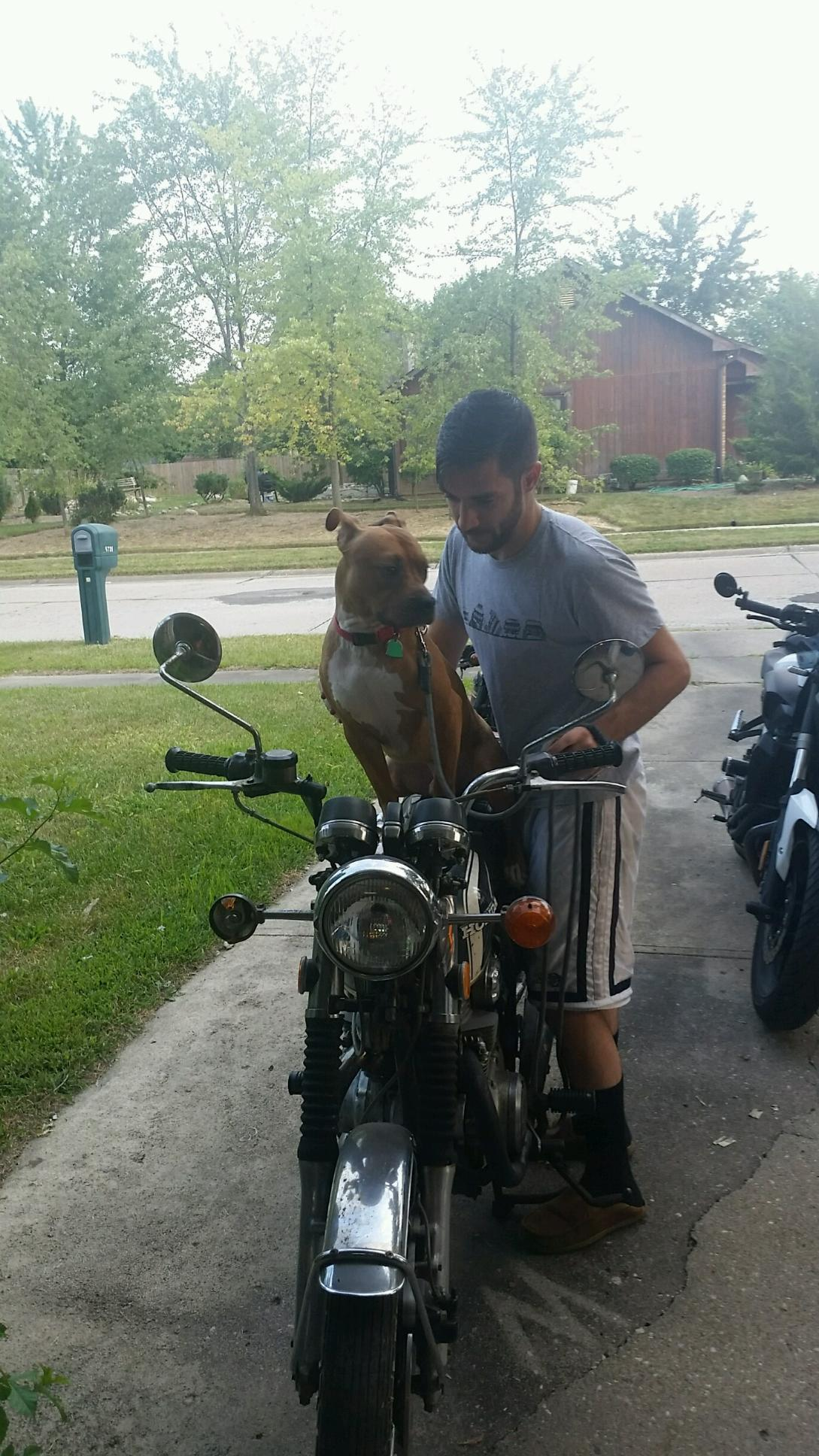 Teaching Red (Craig) to ride a motorcycle. He did not like it.