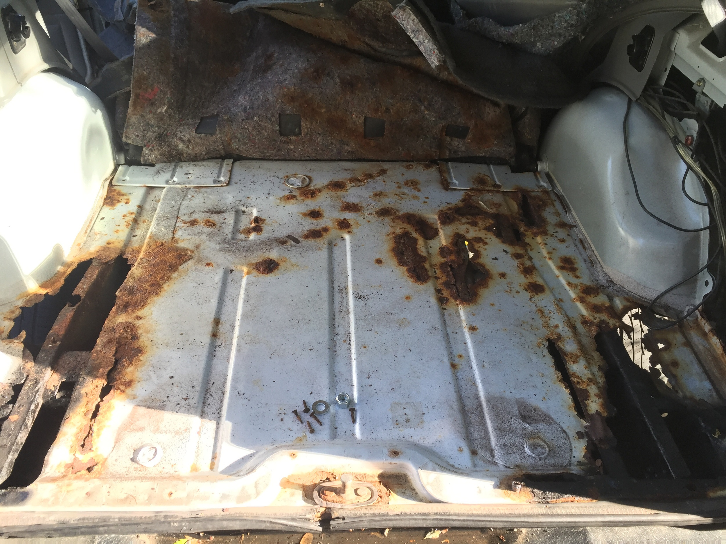 Floors are all rusty. Planning on replacing every rusty panel starting from the rear and moving towards the front! Stay tuned for updates!