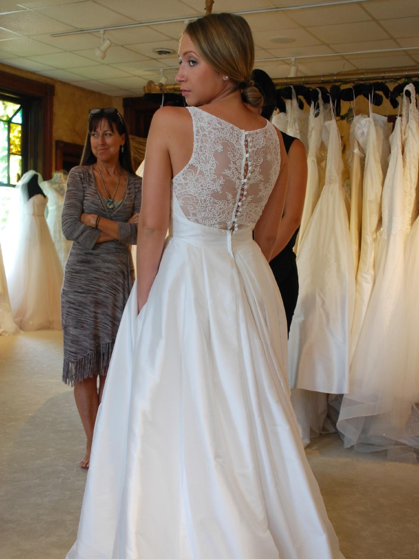 Box pleats, pockets, and a lace back...true love!