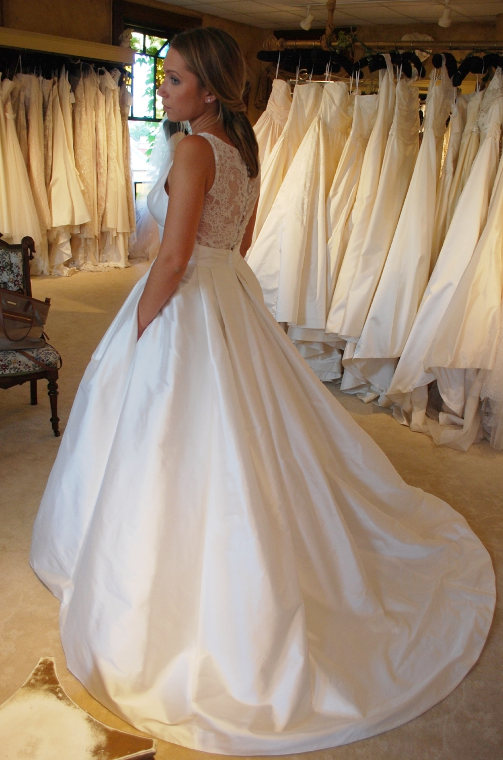 """""""Cherish"""" silk wedding gown by  LeaAnn Belter  shown at  Something Bleu Bridal  in Saratoga Springs, NY."""