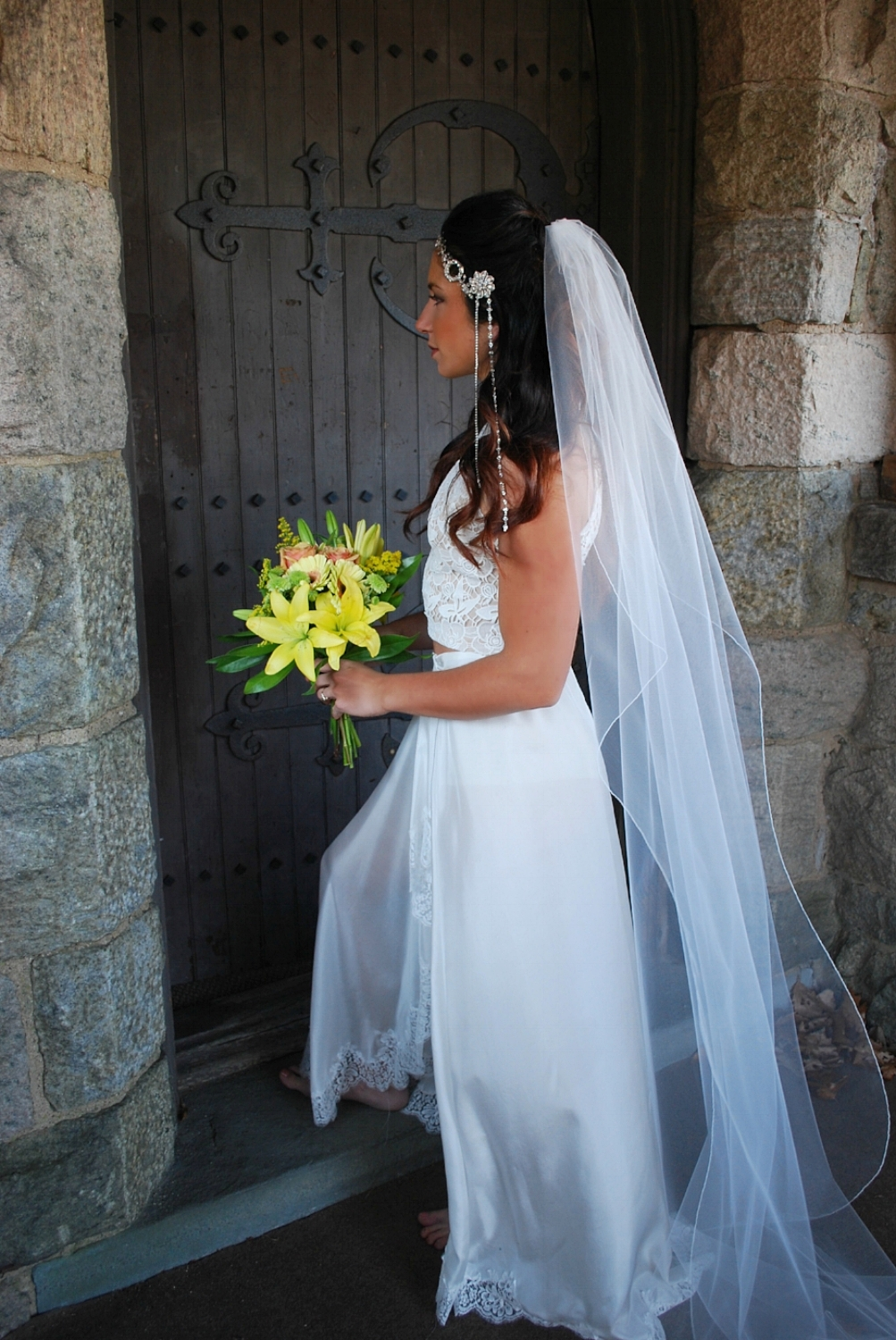 PIctured is our April headpiece with Sadie brooch, Anna veil, and custom silk and chantilly lace bridal skirt modeled by  The Bride Trainer .