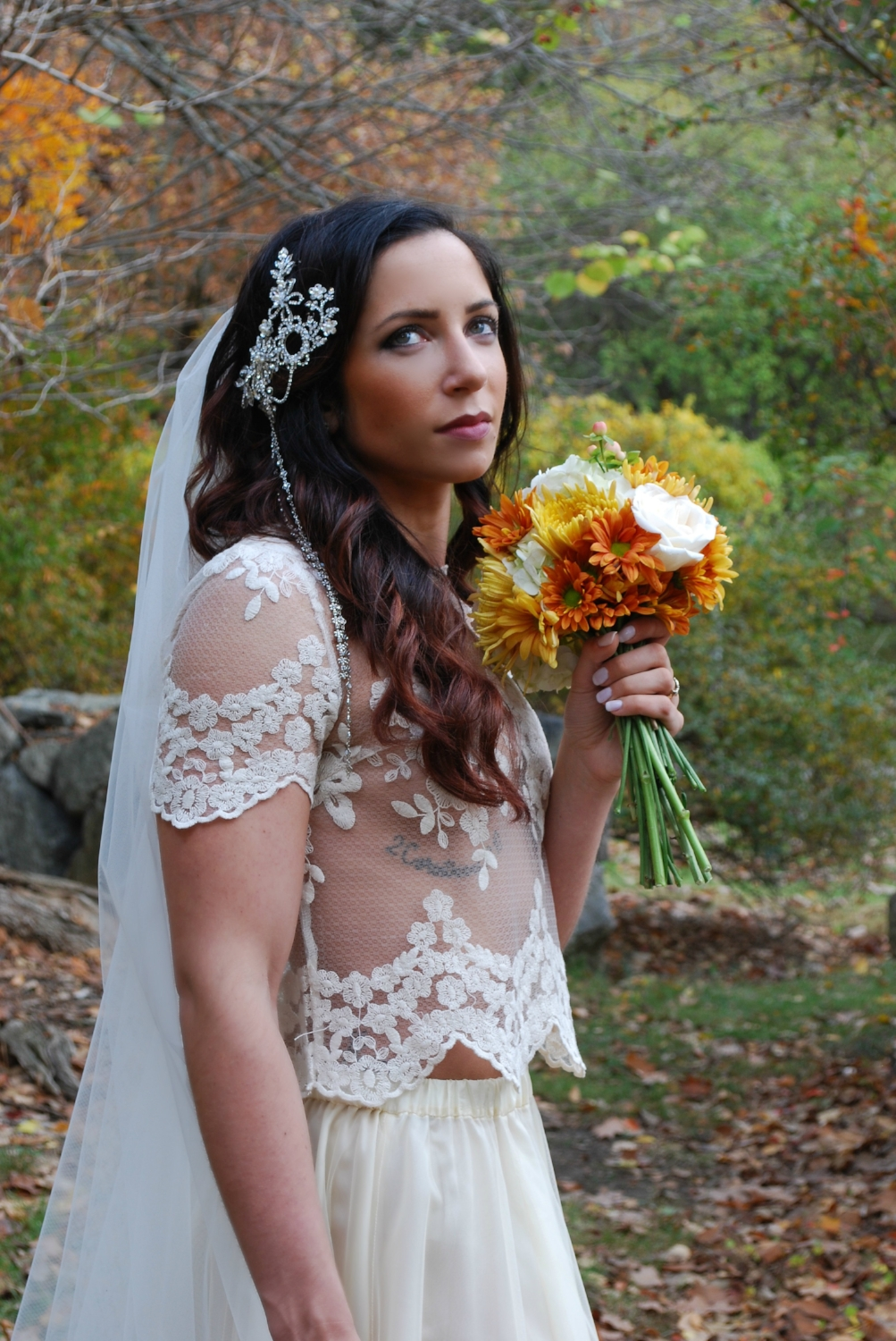 Pictured is our Codie headpiece with Codie drape, soft European net Lizette veil, and custom silk and European net bridal skirt modeled by  The Bride Trainer .