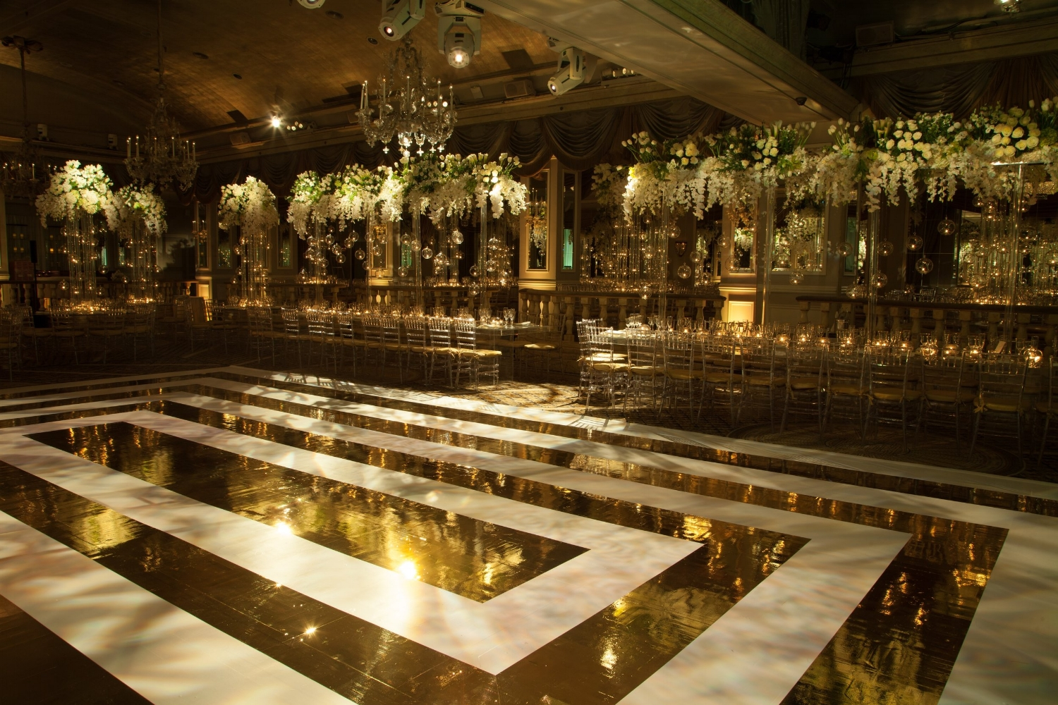 """Every time I look at at this pic my heart stops! This incredible """"gold mirror and white"""" dance floor was created by Bombshell Graphics.  Event planning by Konstantinos Floral"""