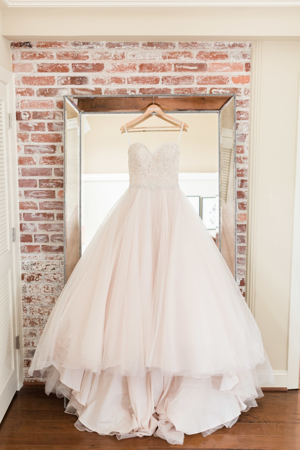 Candace's wedding dress was by Allure Romance Collection.