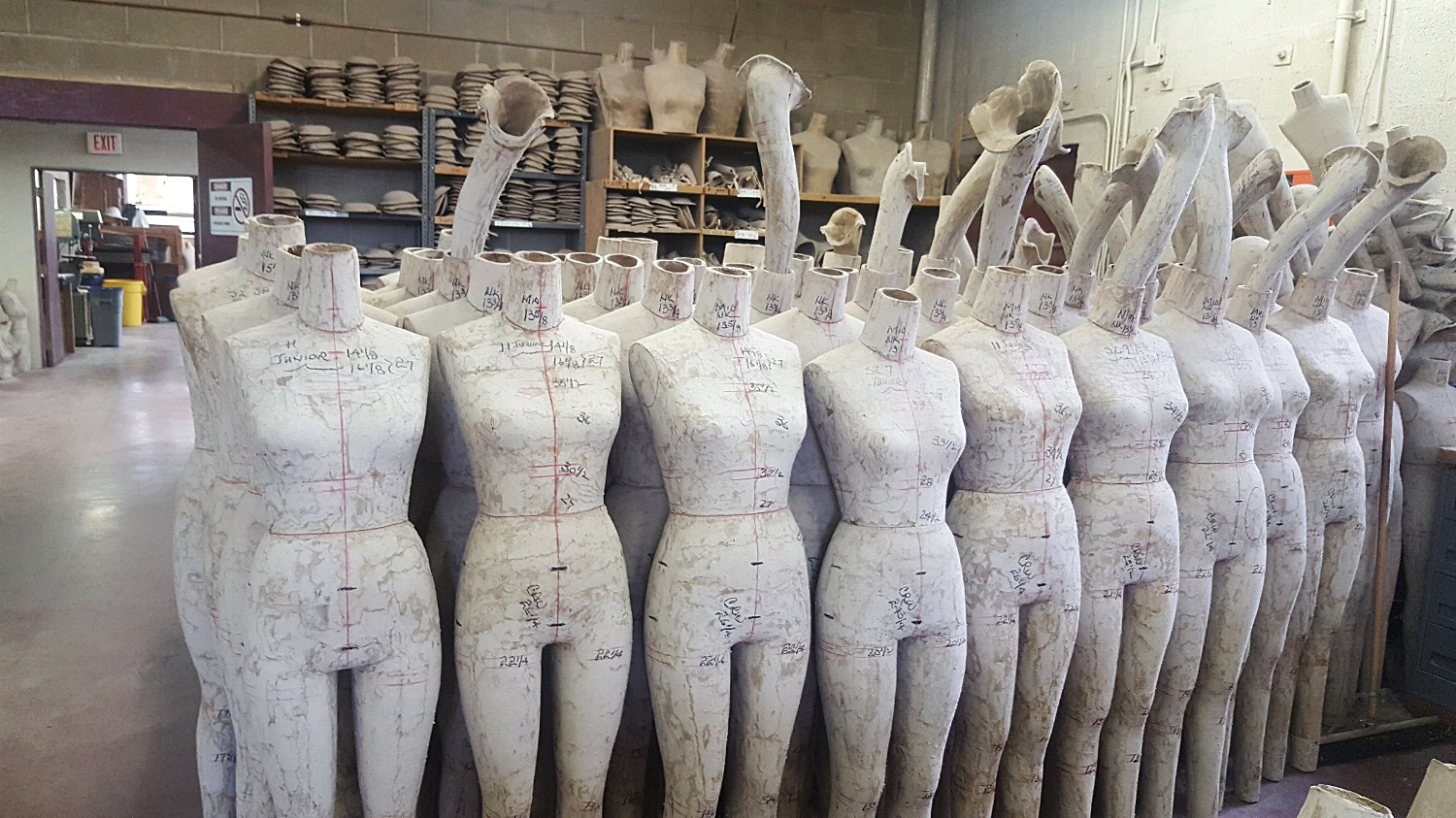 I love this picture! ---Forms, measurements, pencil markings, arms...no arms. My tour of their production facility was way too short. I would have loved to have been locked in here overnight to see if the forms actually come to life when the lights are out.