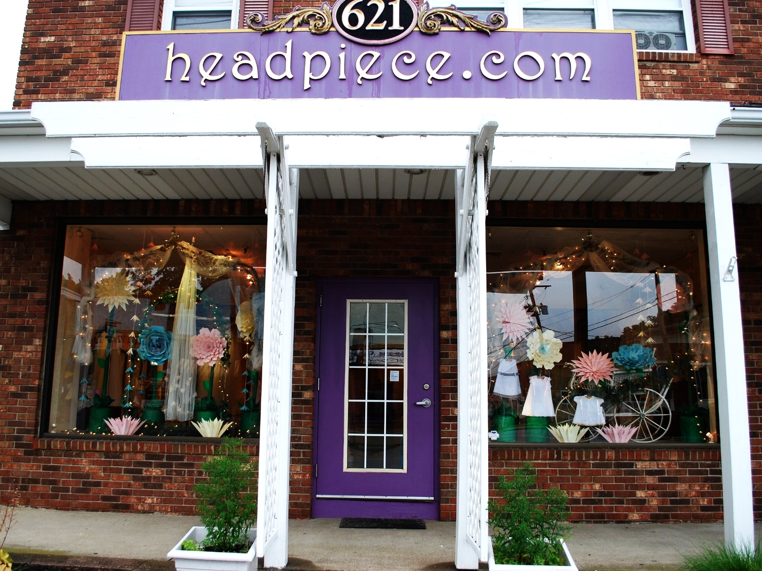 When I saw how incredible her talent was, I told her she could decorate our displays however she liked and granted her full artistic expression. Many people in town have stopped and taken photographs of her more than life size handmade paper flowers.