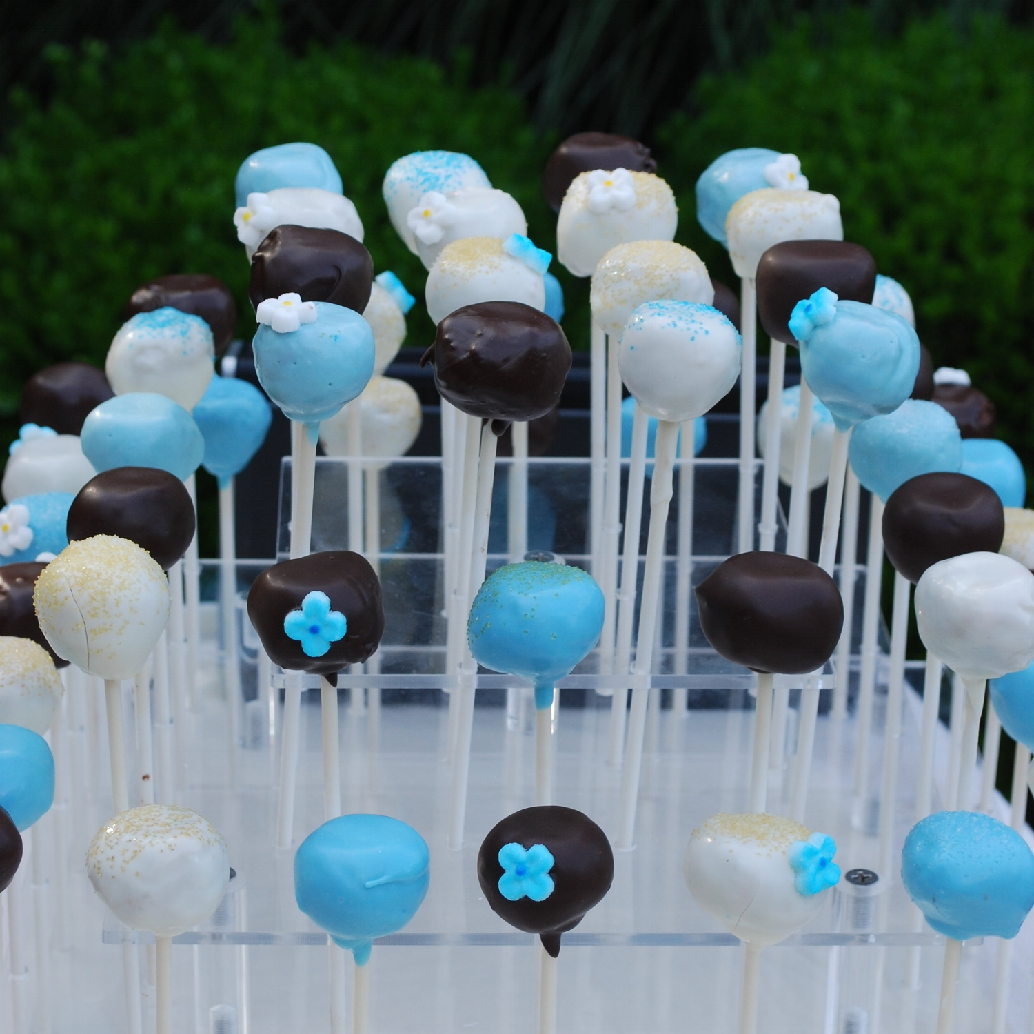 The Baking Diva delivered cake pops in the shower color scheme that sinfully melted off the stick.