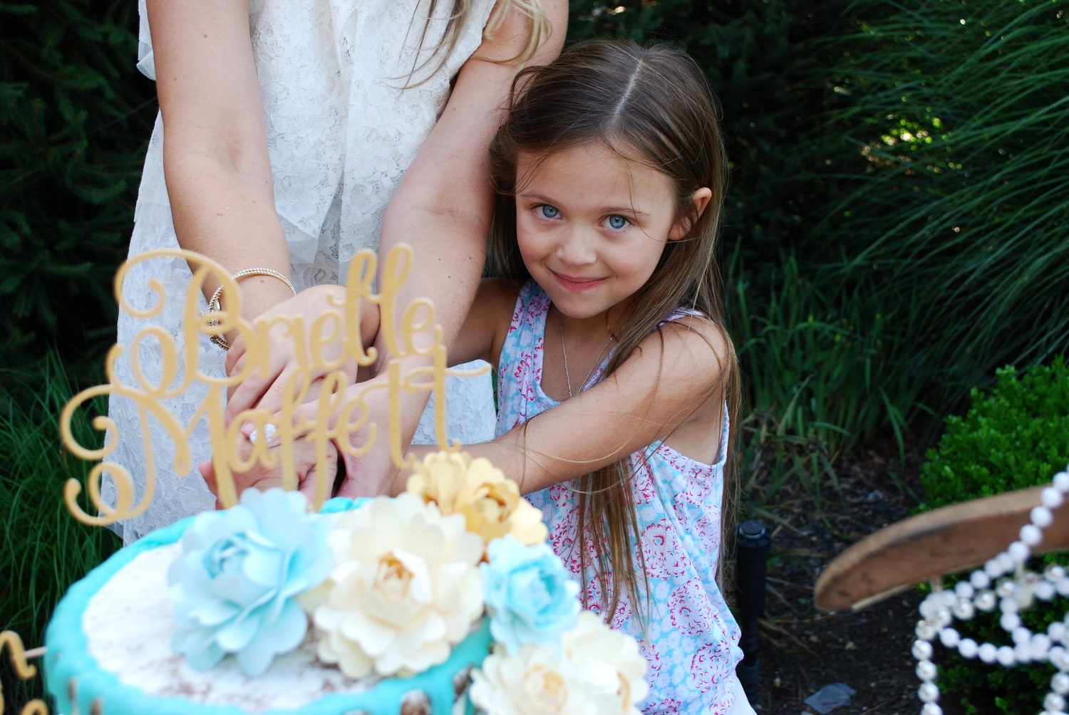 ...and to finish off this beautiful day was little Abbey assisting the future Mrs. Brielle Marie Maffett in cutting the cake.