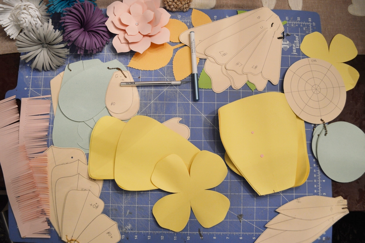 Tina designs her own flower patterns and shapes.