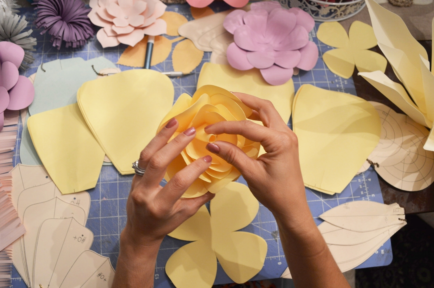 The flat petal shapes are intricately sculpted by hand to create a beautiful 3D flower. Her flowers are made to order and can ship anywhere through her Etsy Shop--  Made Pretty with Paint . Her customers buy her designs for use as decorations for baby nurseries, weddings.....and of course bridal showers!