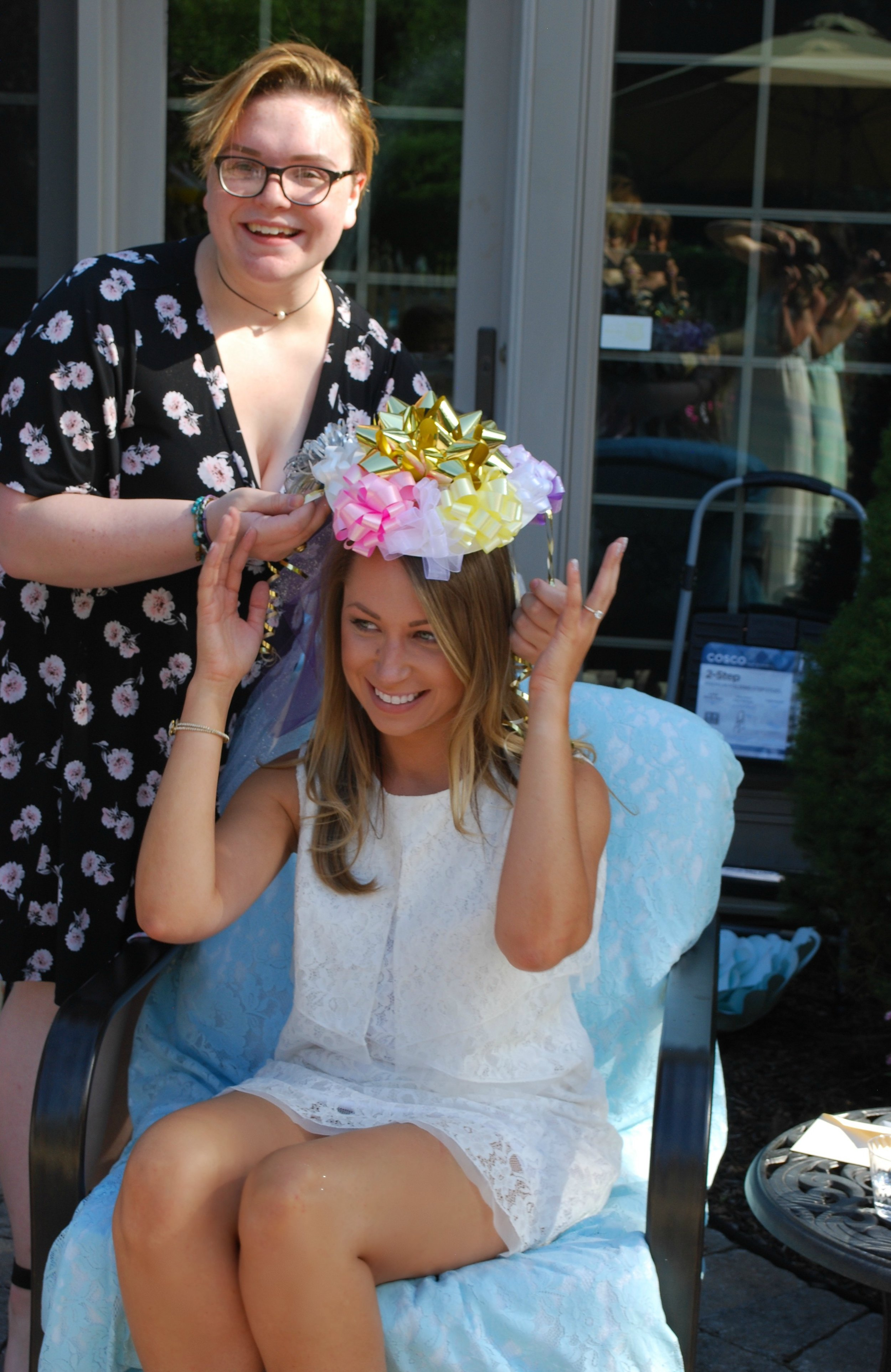 I remember the bow hat thingy at my shower! This moment brings out creativity and always a smile or two! Thank you Mallory (Brielle's cousin) for your millinery mastery!