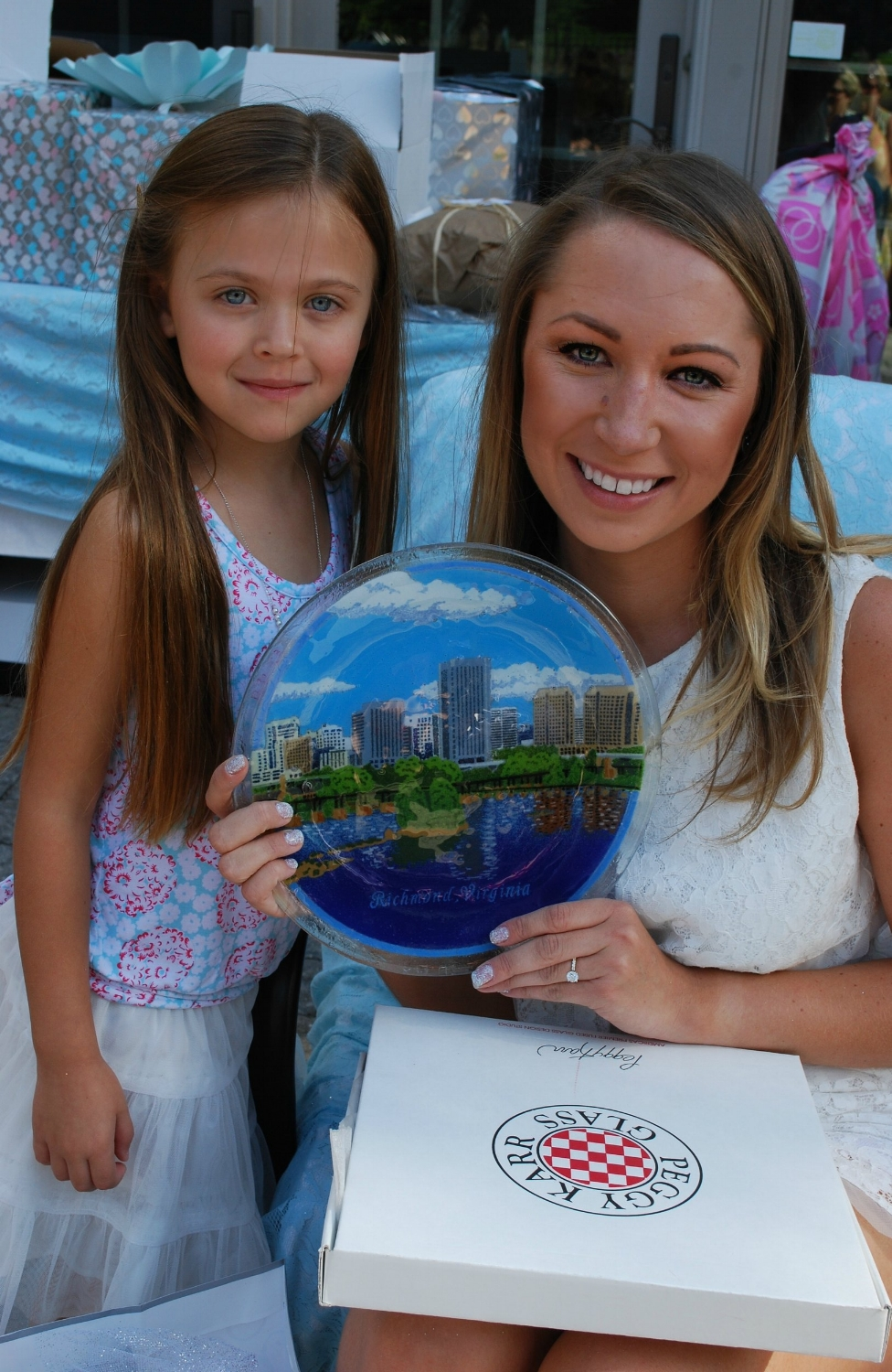 Brielle was so surprised to open this beautiful present from our dear friend, Mary Bott. I think Mary was also surprised to find out that one of the buildings depicted in this artisan glasswork design was actually Alex's office building! Brielle absolutely loved this gift and couldn't wait to show Alex.