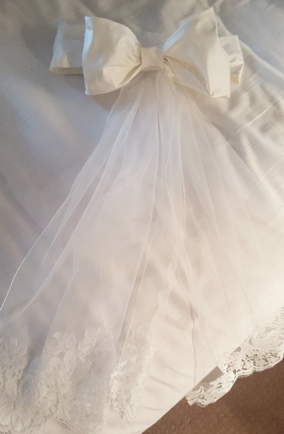 Lea-Ann Belter was so kind to provide us with a tiny piece of lace from Brielle's wedding gown bodice to create a custom sash for Abbey's flower girl dress. The tails of the sash were made from the same silky netting and French lace I used to design Brielle's veil.