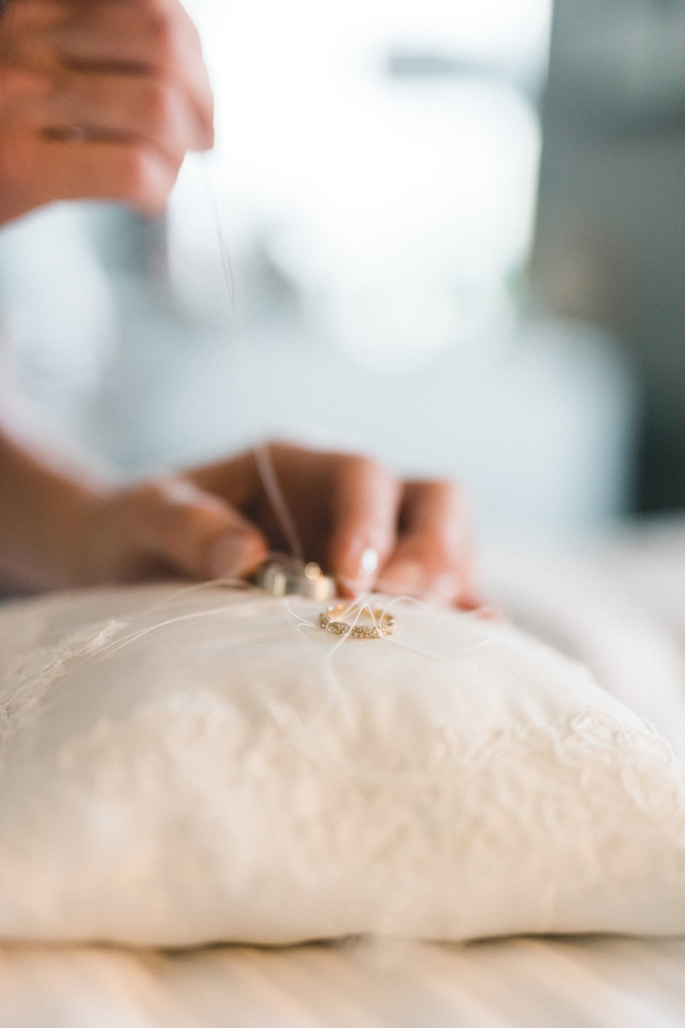 The silk ring pillow was also designed using lace remnants from Brielle's wedding gown. The tailor's tack stitch is always the best way to fasten real wedding rings to the ring pillow. Our handmade ring pillows are so beautiful they can be used for home decor or in a nursery after the wedding.