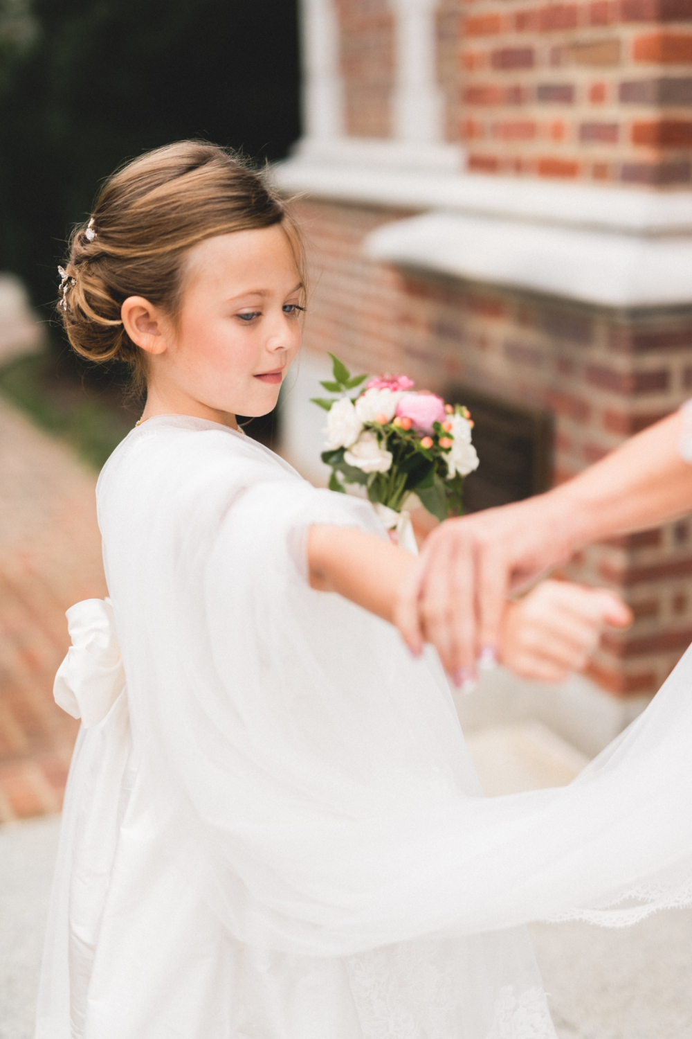 """Abbey's sash was a perfect custom finish for her silk """"Melody"""" dress designed by Isabel Garreton."""