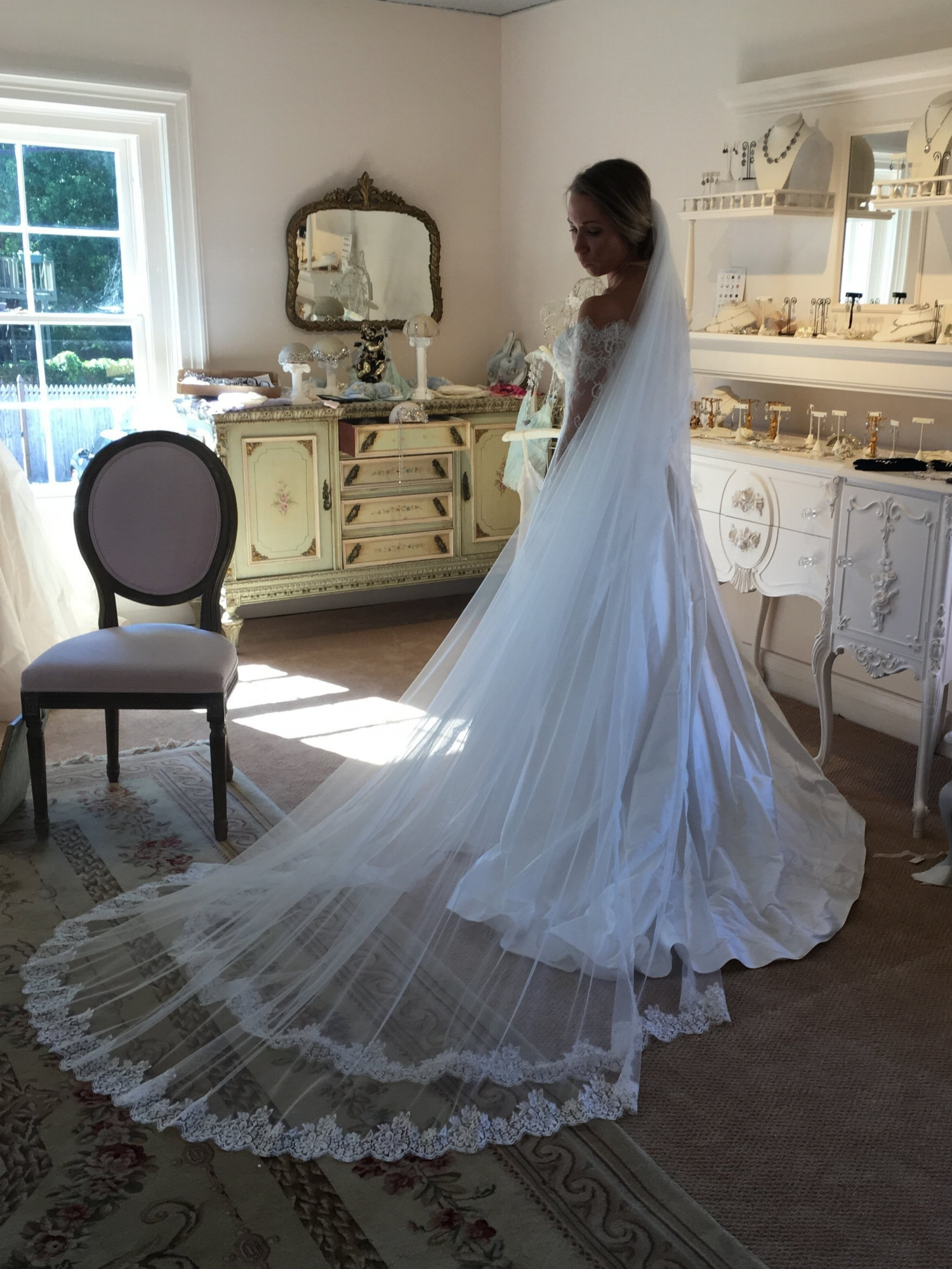 Brielle fell in love with the idea of a two-tier cathedral length veil. This veil was my first draft. We brought it to  Something Bleu Bridal  to try on when she picked up her wedding gown in Saratoga Springs, NY. While this is by no means a professional photo, it is one of our favorites taken in their brand new accessory salon.