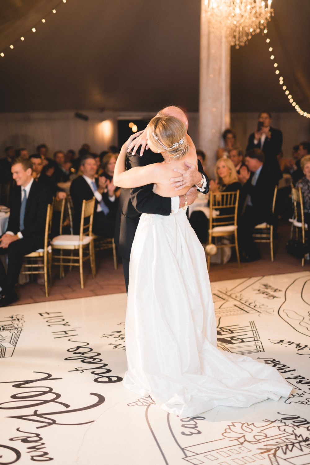 After the first few dances, the bustle came undone, and my dress literally swept the floor. I tried to adapt by holding my train with the wrist loop....until that broke too! This photo of dancing with my dad is even more beautiful because of it.