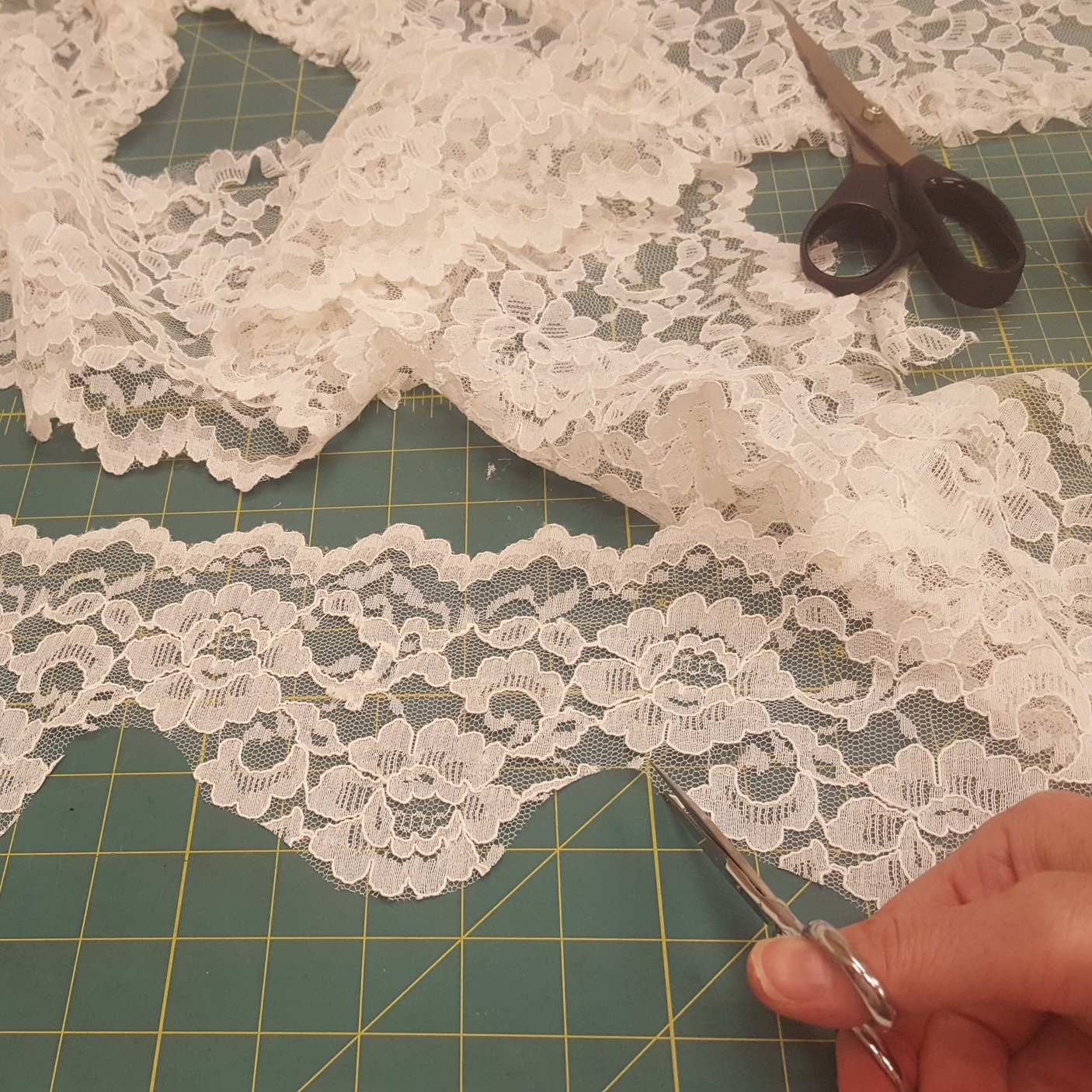 The lace was cut precisely and pinned to perfectly mirror the pattern on each side of the veil.