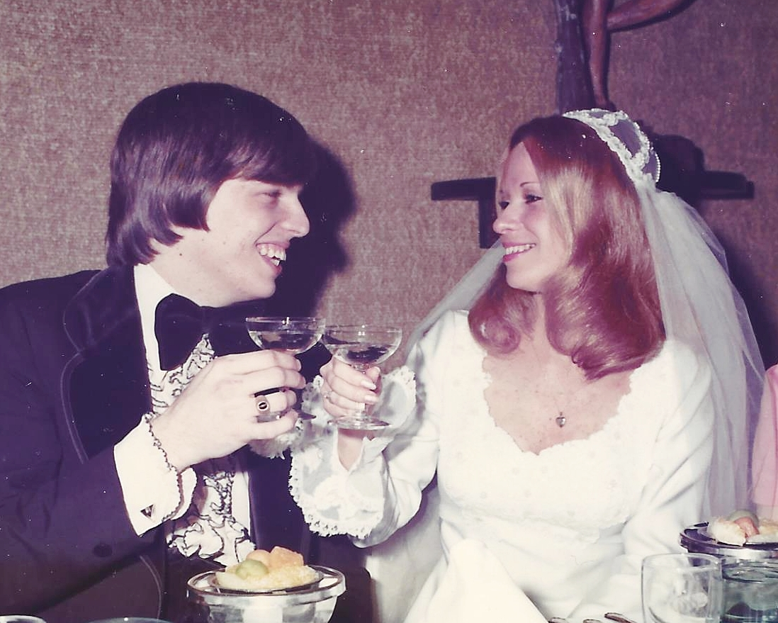 JIm and Patti Dreher toasting on their wedding day.