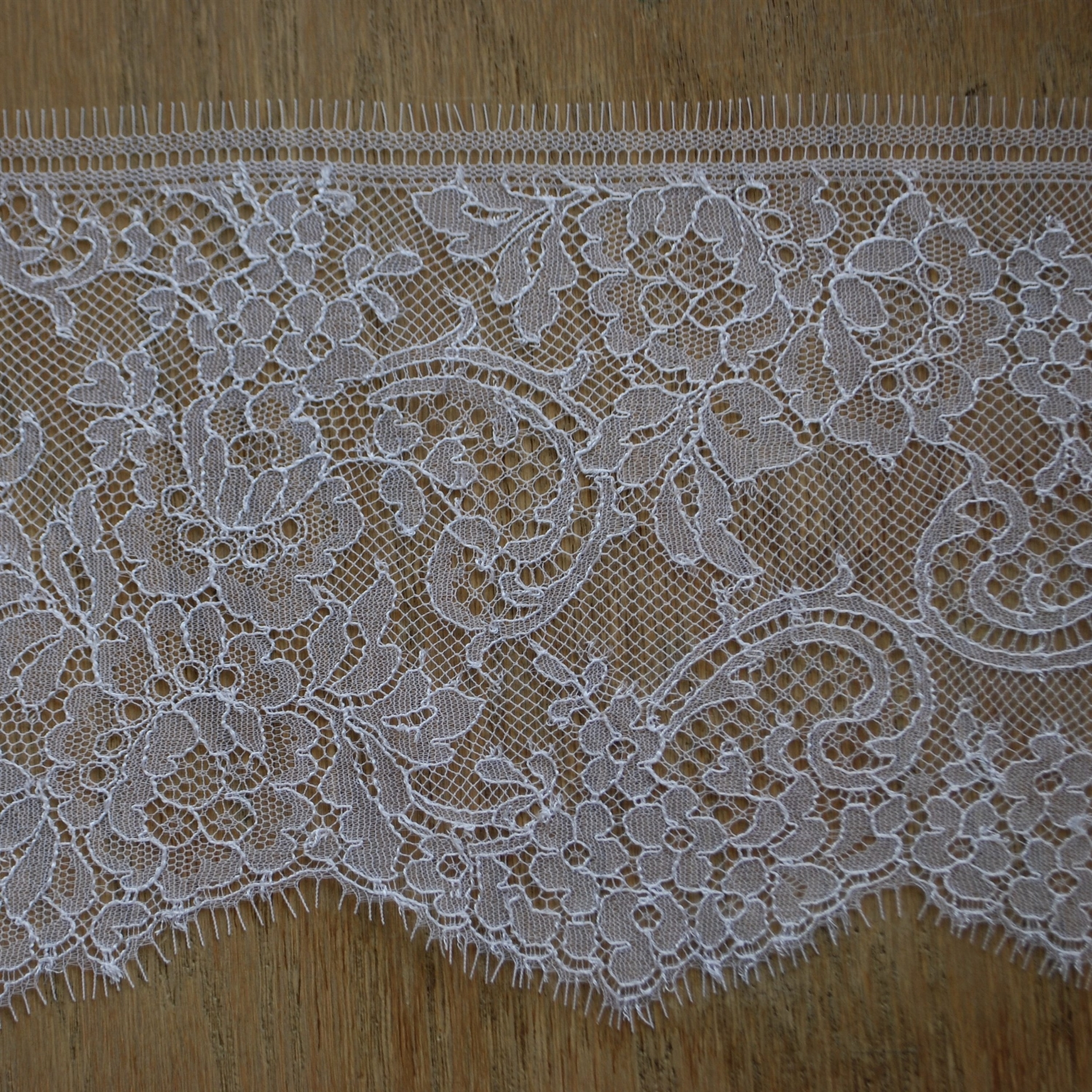 Chantilly is an extremely fine bobbin lace. It is so soft you can sleep in it.