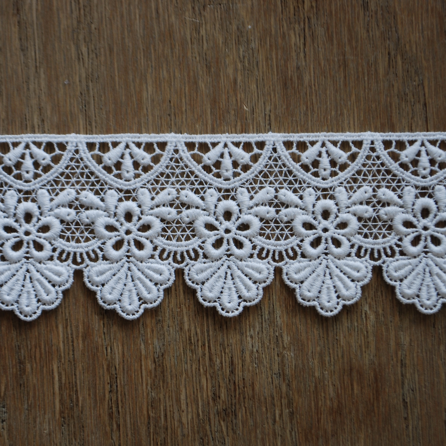 Guipure is a heavy lace created over a coarse mesh ground. It is pronounced (gee-poor).