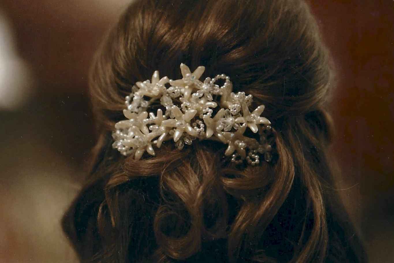 In 2009, Amy's sister Dana wore the wax flower headpiece for her wedding, followed by their cousin Alissa in 2013.