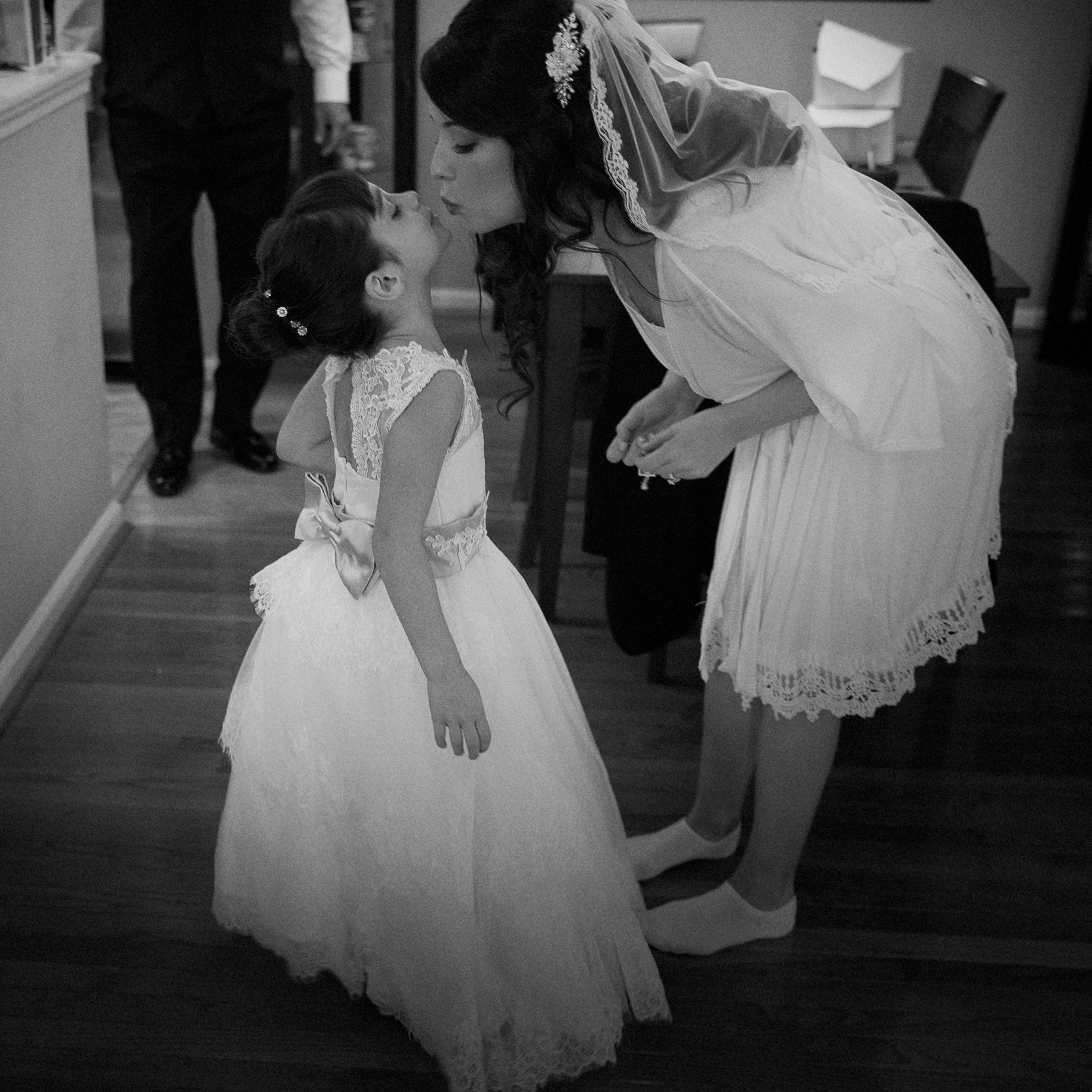 Nuggie flower girl pics are a favorite of mine. Kisses for the bride are a must on her wedding day!