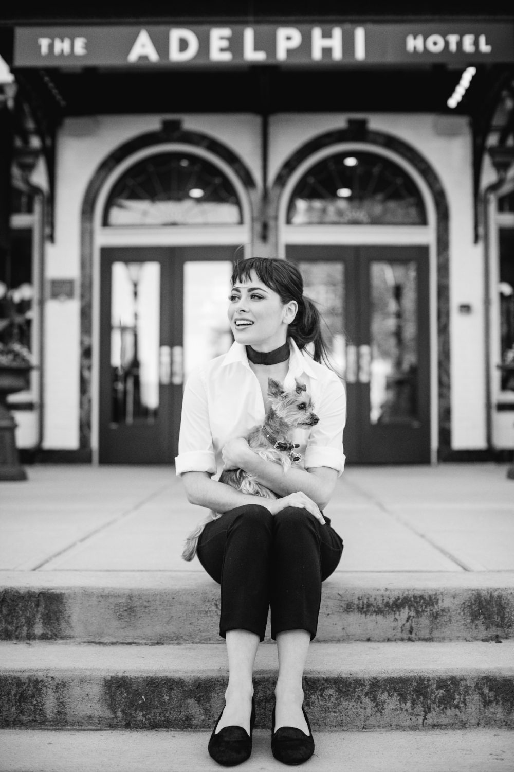 Nina Jade is relaxed and ready to shoot on the steps of the Adelphi Hotel in her comfy smoking slippers by  Birdies  of San Francisco, also a favorite of Meghan Markle.