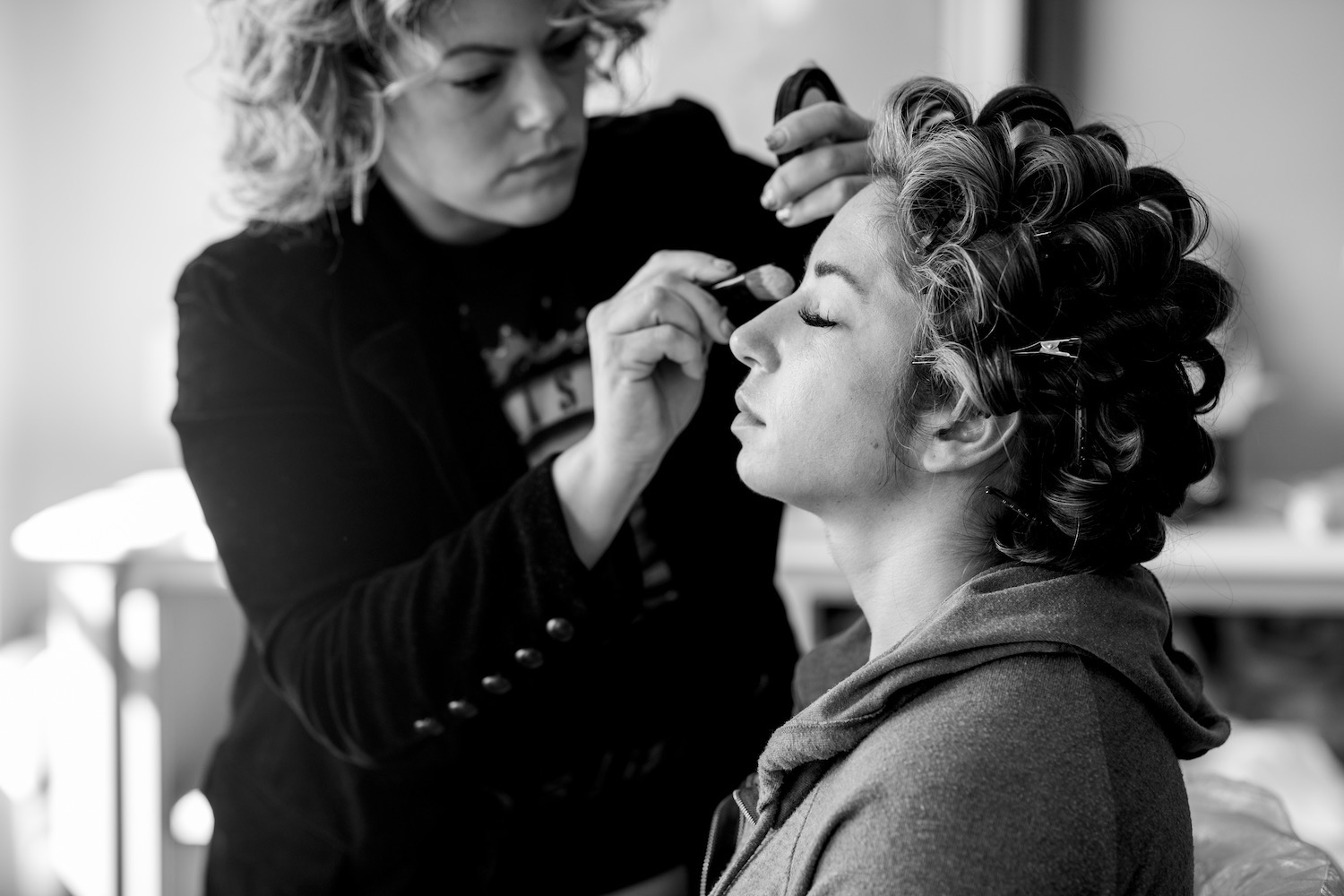 Lia Zangari, owner of Bliss Salon, set Aubrey's hair for her masterful down-style while Justine artistically prepares our model for the camera.