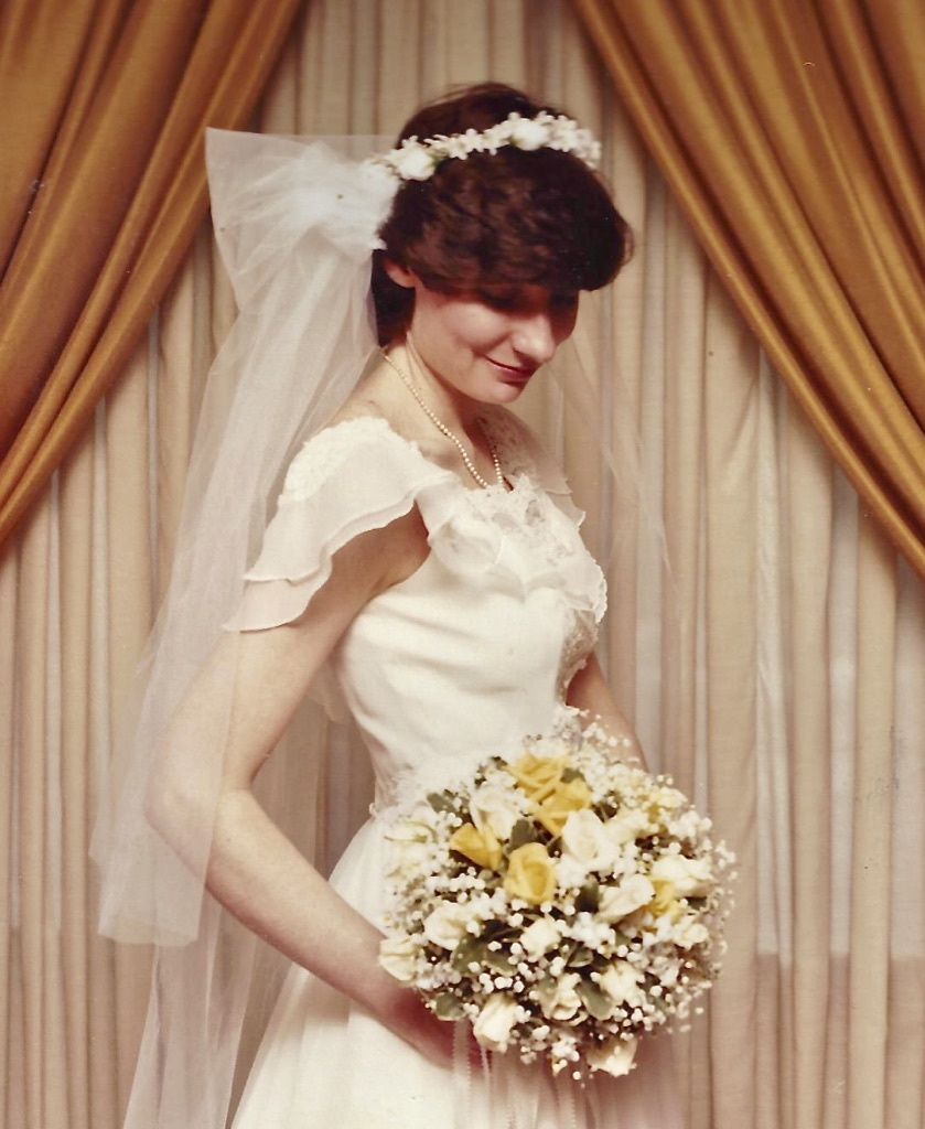 What appears to be a pouf at the top of Maureen's veil was actually a soft cowl that served as a light face blusher as she walked down the aisle. I love this design idea to this day and wish to revive it in the cycle of wedding fashion.