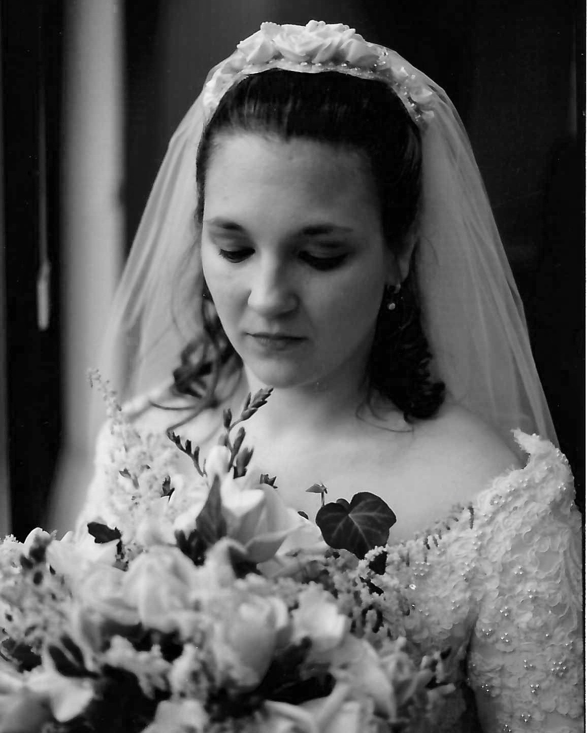 I designed Dawn's headpiece in 1999 before our opening. Her headpiece frame was custom made and created from buckram and wire. The silk flowers on her headpiece were cut from pastel-colored silks to tie in softly with her bouquet.