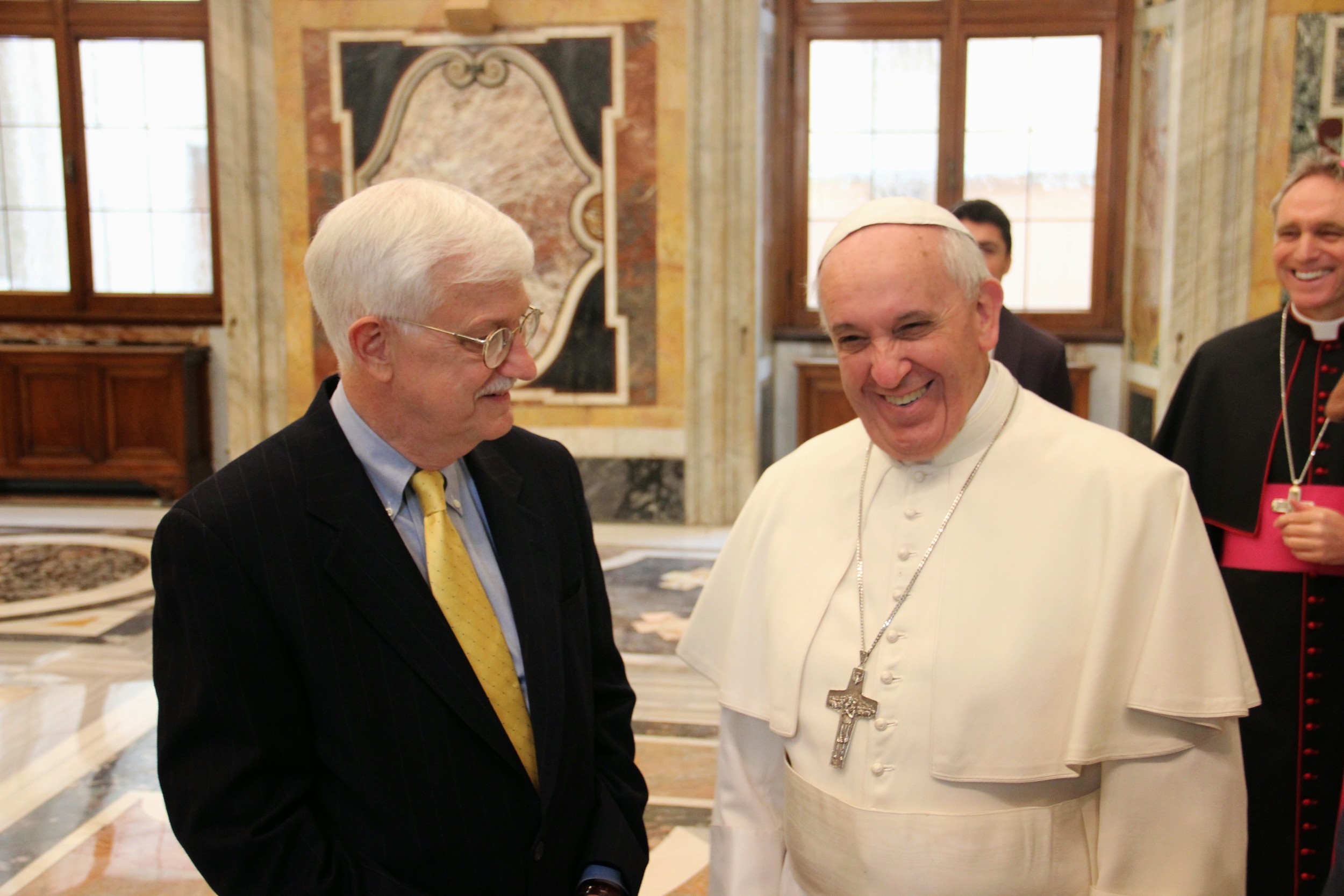 Tom Farr talks with Pope Francis during a special audience at the Vatican.