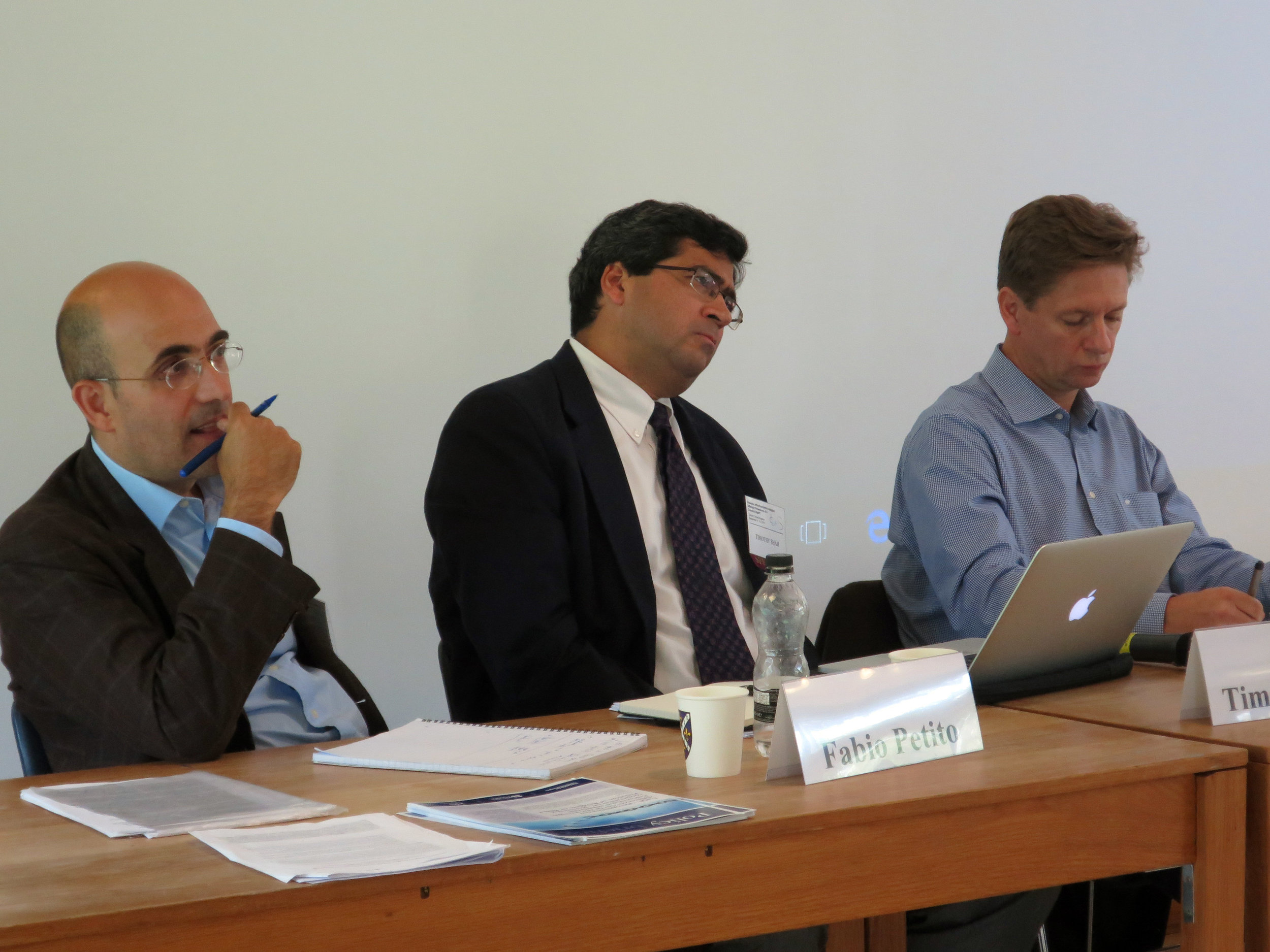 Tim Shah, Senior Advisor, (center) and co-panelists respond to audience questions