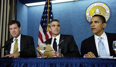 Senator Sam Brownback with then-Senator Barack Obama and actor George Clooney at 2006 press conference to raise awareness of Darfur crisis and genocide. Photo: AP