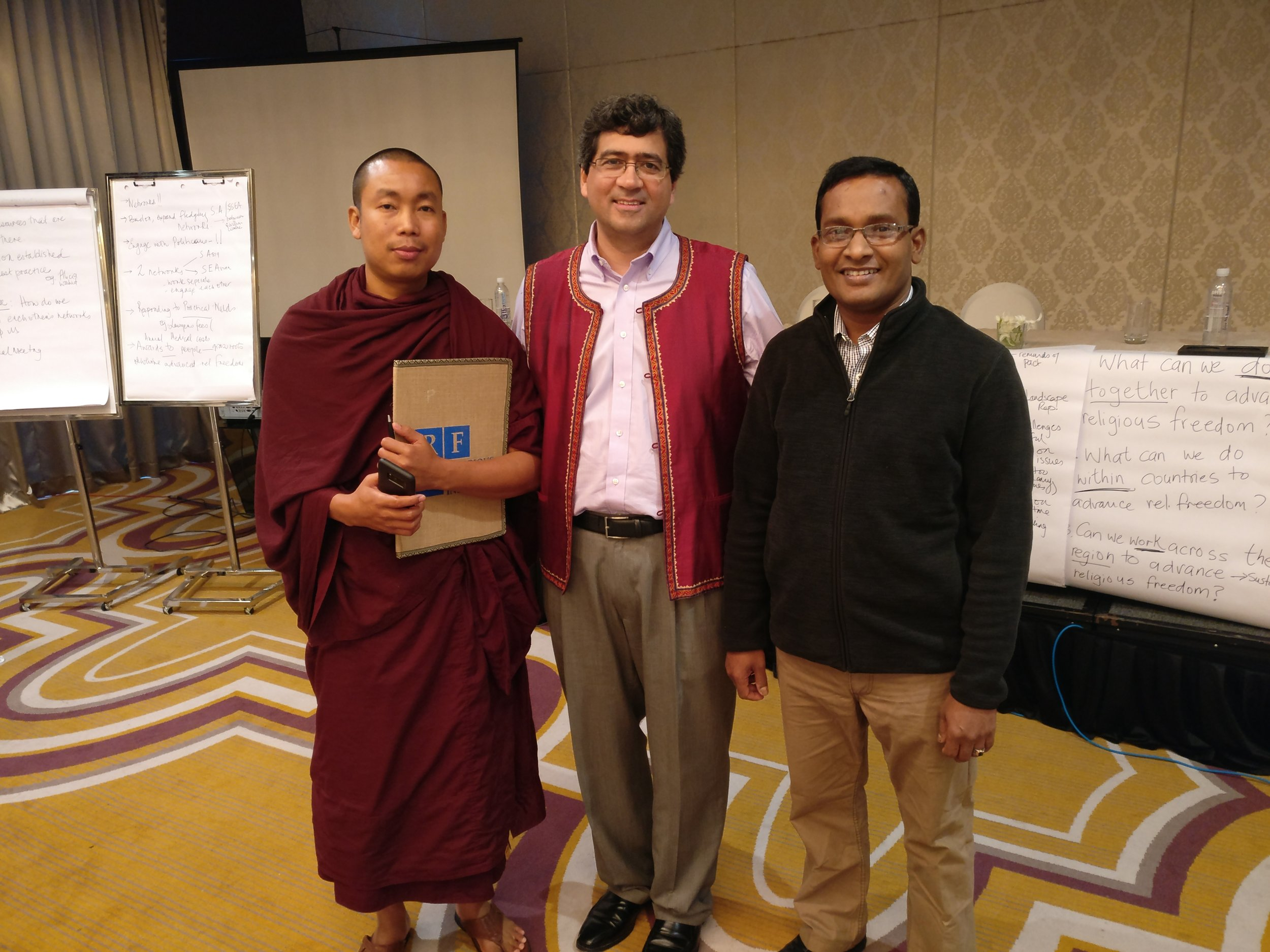 Ashin Zero and Sam Naeem with RFI Action Team Director Timothy Shah. (Photo: RFI)