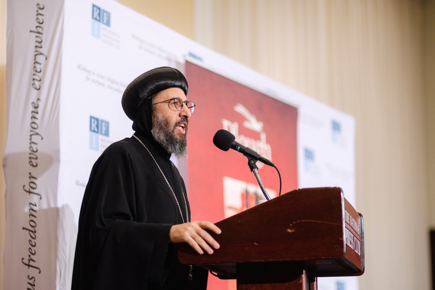 Archbishop Angaelos, Coptic Orthodox Archbishop of London gives keynote remarks on the impact of this event on the Coptic community of Egypt.  Photo: RFI/Nathan Mitchell
