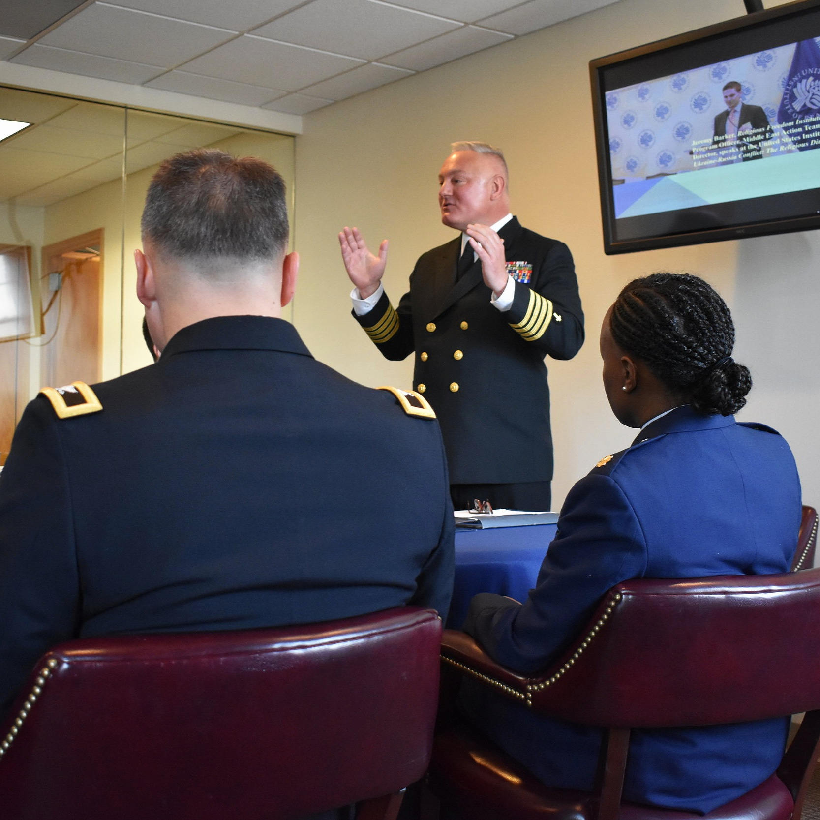 Rev. Daniel L. Mode, CAPT, CHC, USN, Religious Freedom Institute Chaplain Fellow, addresses Chiefs of Chaplains (Army, Navy, and Airforce) and the Ambassador at Large of International Religious Freedom Sam Brownback during a closed door meeting about the intersection between national security and religious freedom.