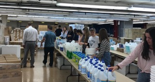 LDS and Bosnian Muslim youth work alongside each other on a service project