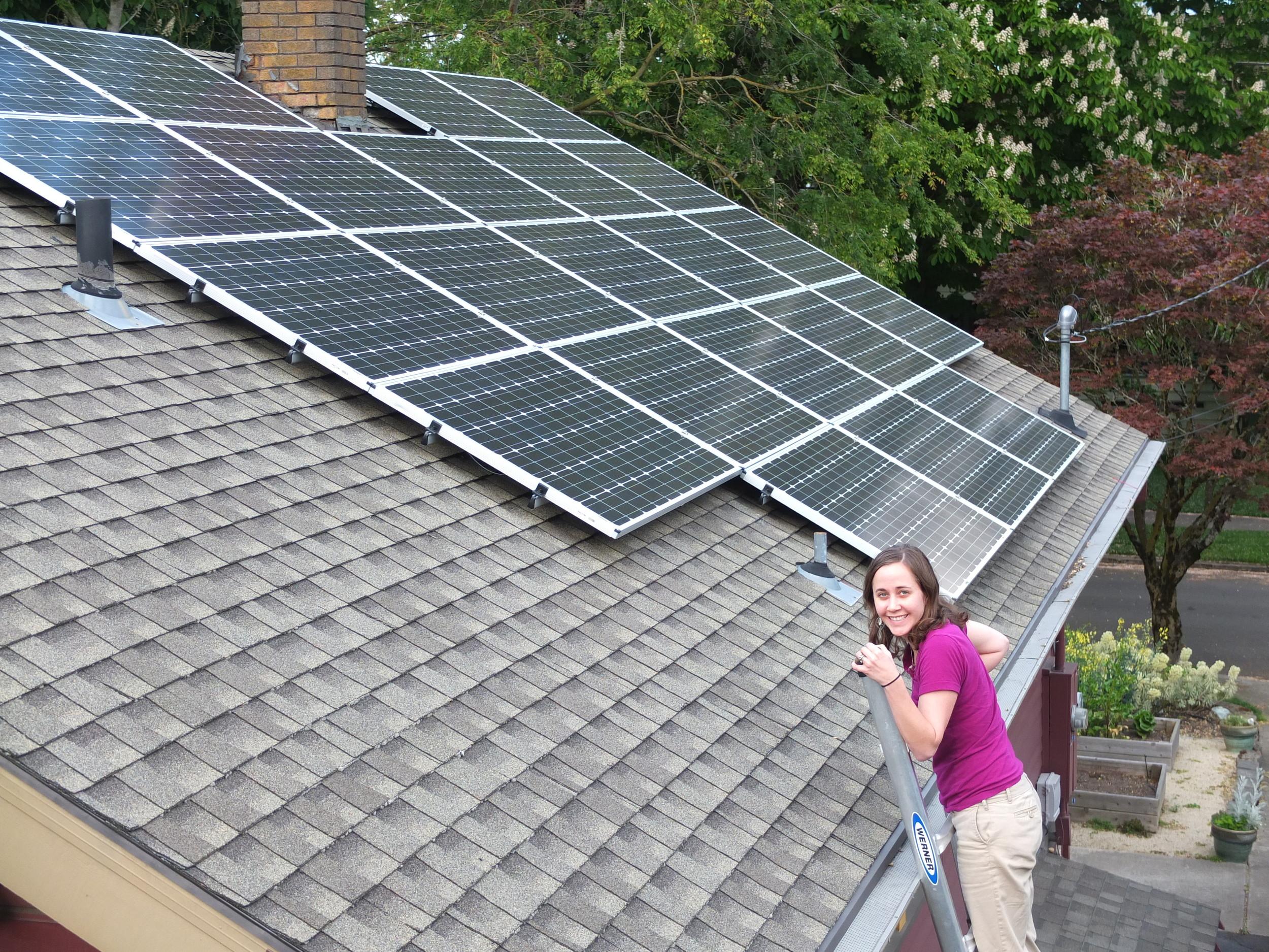 The solar panel installation powers the house and cedar hot tub.